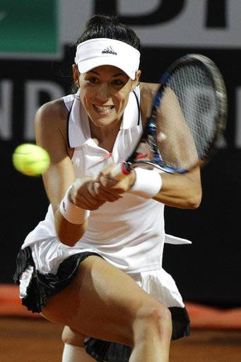 Spain's Garbine Muguruza returns the ball during a quarter finals match against Venus Williams of the United States at the Italian Open tennis tournament, in Rome, Friday, May 19, 2017.