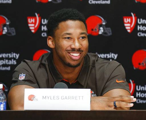 "FILE - In this April 28, 2017, file photo, Cleveland Browns' Myles Garrett answers a questions during a news conference at the NFL team's training facility in Berea, Ohio. Top overall draft pick Myles Garrett has signed his rookie contract with the Cleveland Browns. Garrett's four-year deal is worth an estimated $30.4 million and includes a $20.3 million guaranteed signing bonus. The former Texas A&M All-American signed his contract on Friday, May 19, 2017, and the Browns posted a video of Twitter of Garrett filling out the paperwork while Seal's ""Kiss From A Rose� played in the background. (AP Photo/Ron Schwane, File)"