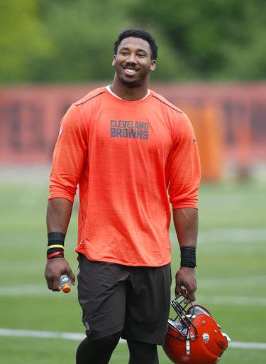"FILE - In this May 12, 2017, file photo, Cleveland Browns' Myles Garrett walks off the field during an NFL football rookie minicamp in Berea, Ohio. Top overall draft pick Myles Garrett has signed his rookie contract with the Cleveland Browns. Garrett's four-year deal is worth an estimated $30.4 million and includes a $20.3 million guaranteed signing bonus. The former Texas A&M All-American signed his contract on Friday, May 19, 2017,  and the Browns posted a video of Twitter of Garrett filling out the paperwork while Seal's ""Kiss From A Rose� played in the background."