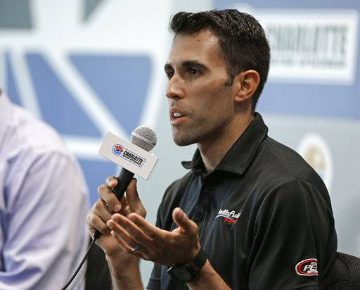 Aric Almirola speaks to the media during a news conference before practice for Saturday's NASCAR Cup series All-Star auto race at Charlotte Motor Speedway in Concord, N.C., Friday, May 19, 2017. Almirola was injured in a crash during a race last week and will be out for 8-12 weeks.