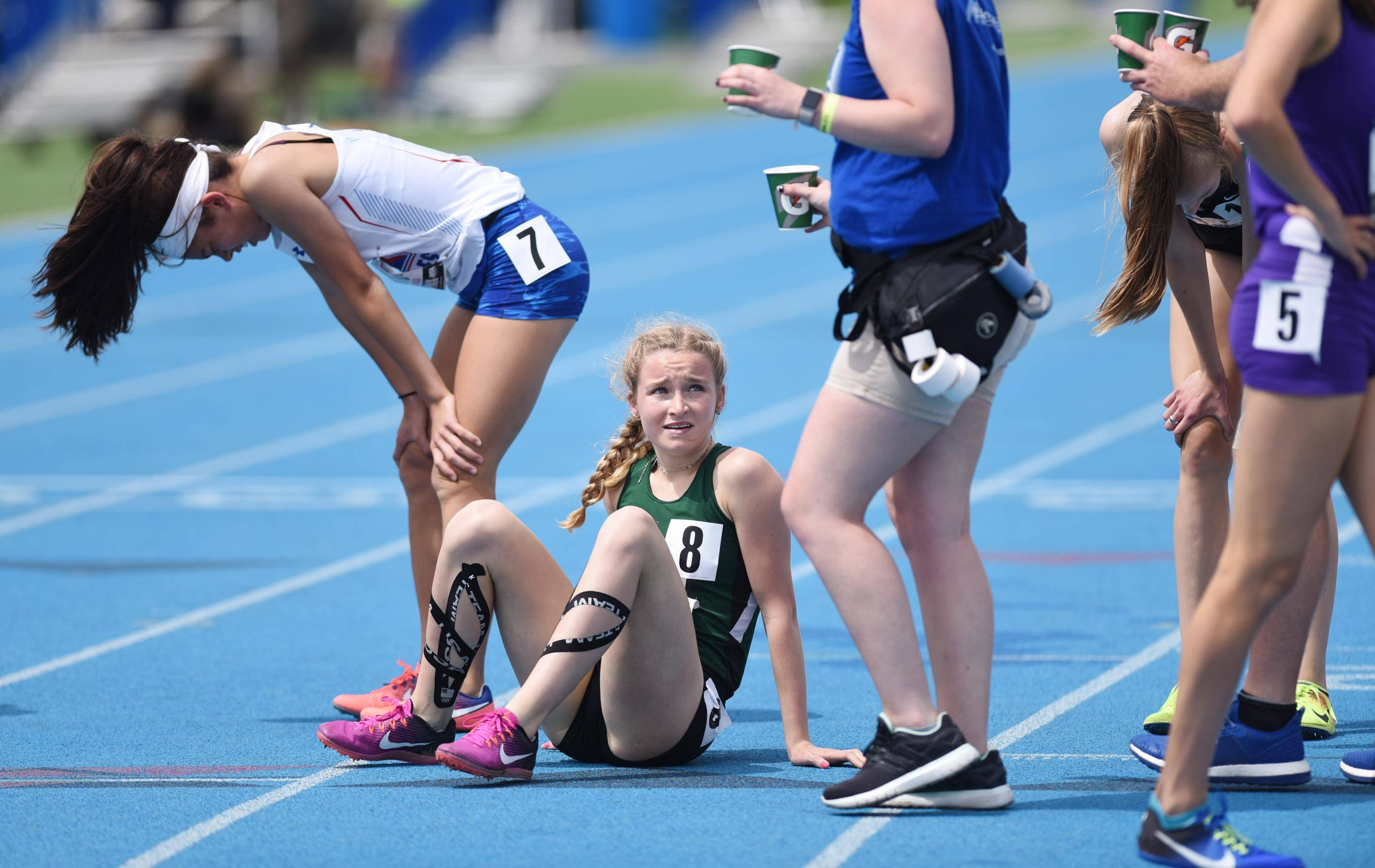 Glenbard West's Janie Nabholz reacts at the finish of the Class 3A 800-Meter Run at the state girls track and field meet finals on Saturday at Eastern Illinois University in Charleston.