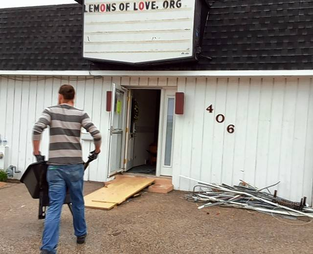 A volunteer heads into the future home of Lemons of Love, a cancer support organization.