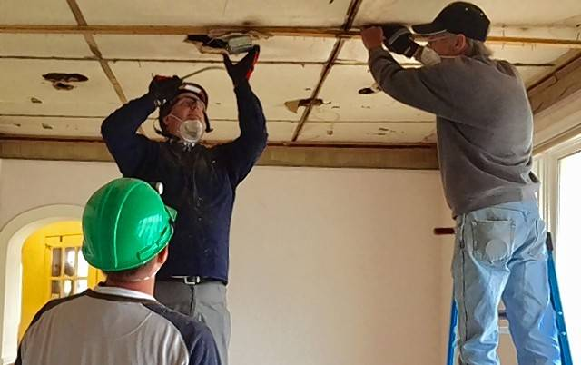 Volunteers including Mount Prospect Assistant Fire Chief Bryan Loomis, center, are renovating a former office building to become the new home of Lemons of Love, a cancer support organization.