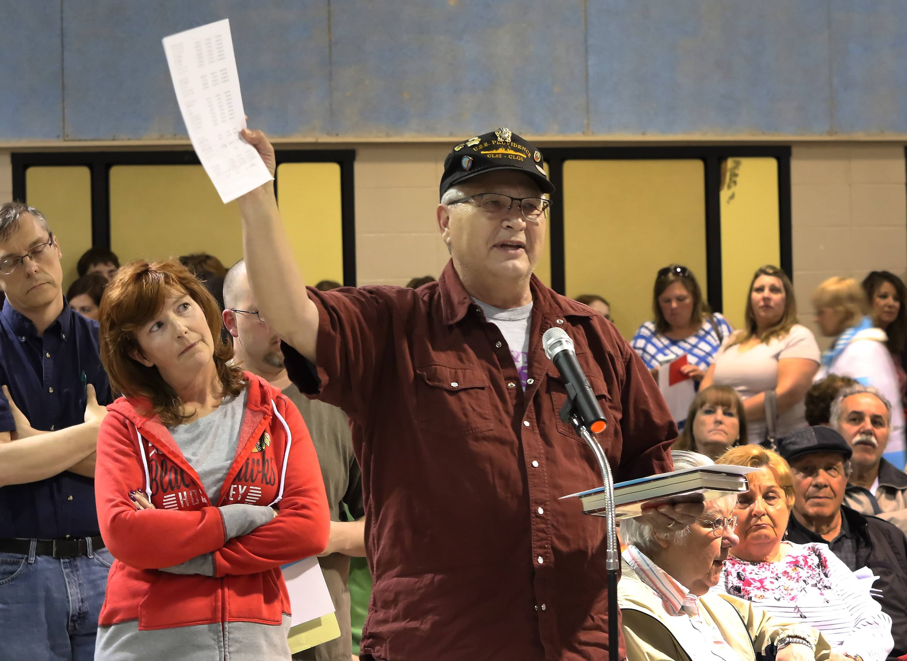 Lake Villa resident Larry Kurtz voices his displeasure during the town hall meeting Monday on whether to authorize the Lake Villa Township board to move forward with the proposed purchase of Antioch Golf Club.