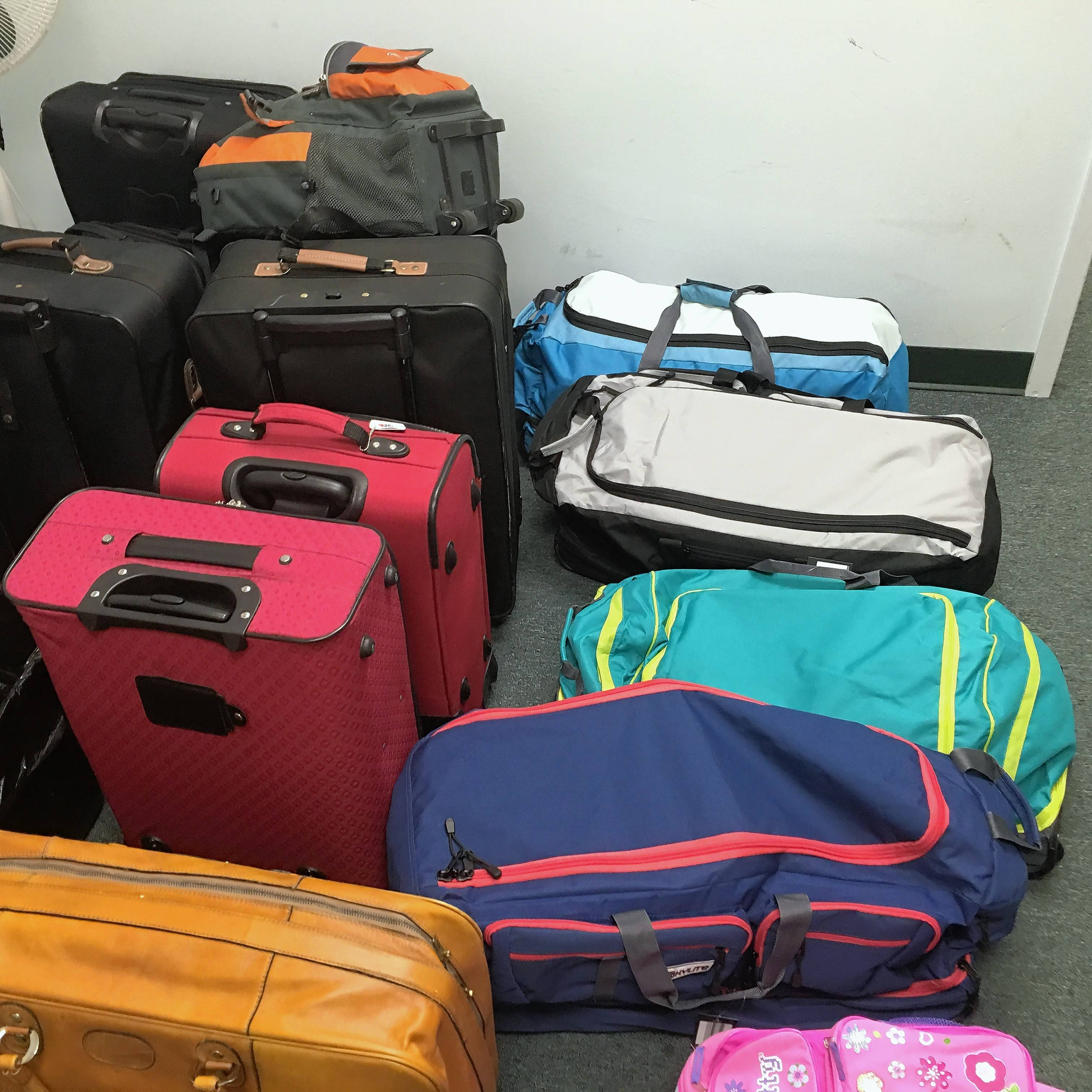 These suitcases were collected by the fifth-grade Girl Scout troop from Virginia Lake School in Palatine.