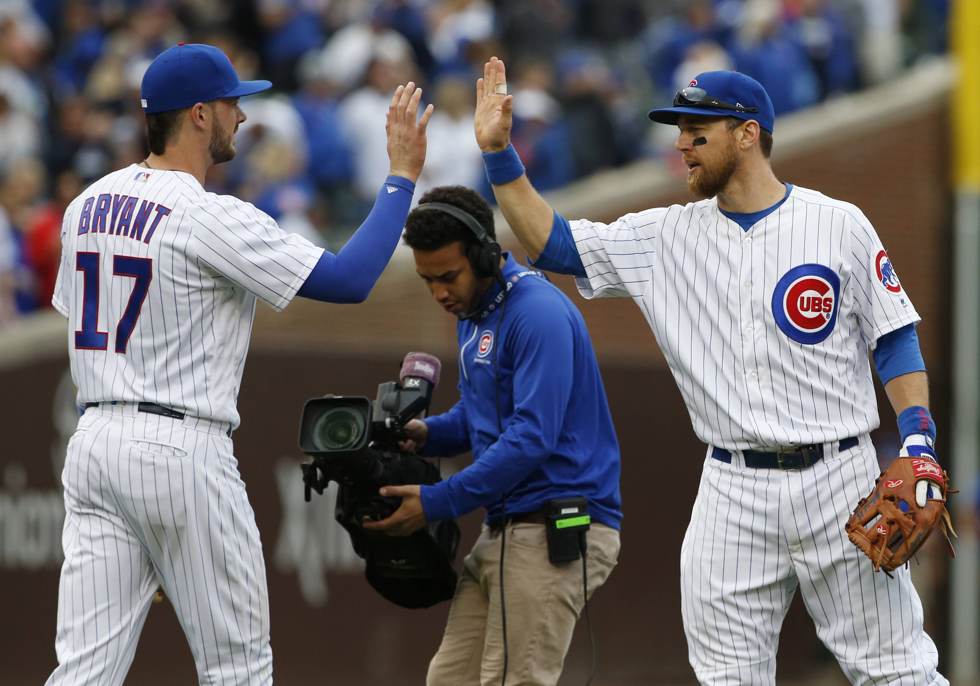 Cubs' Kris Bryant celebrates with Ben Zobrist after they defeated the Milwaukee Brewers Sunday in Chicago.