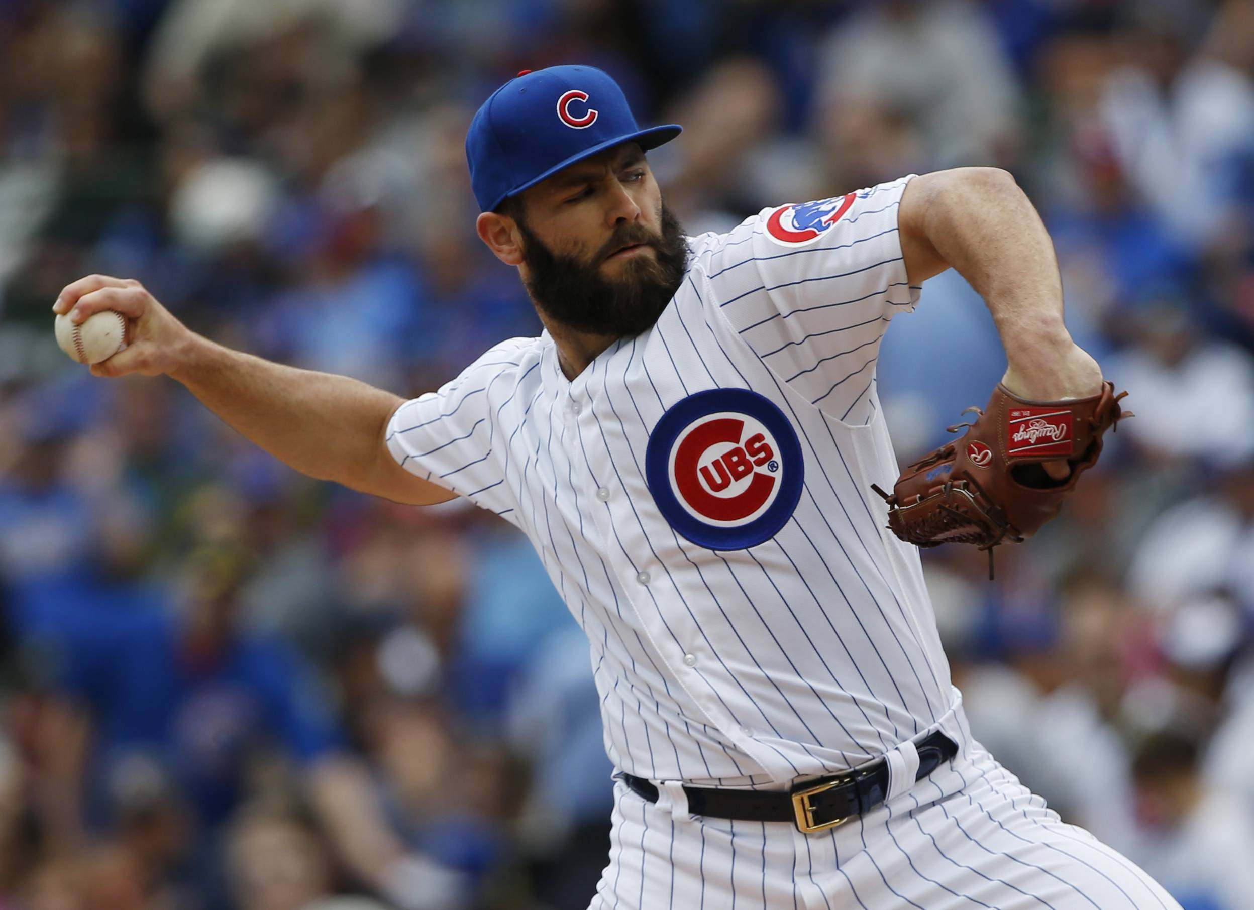Chicago Cubs starting pitcher Jake Arrieta throws against the Milwaukee Brewers in the first inning of a baseball game in Chicago, Sunday, May 21, 2017. He got an extra day of rest because Saturday's game was postponed by the Cubs, a decision questioned by the Brewers. (AP Photo/Nam Y. Huh)