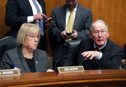 FILE - In this Jan. 31, 2017 file photo, Senate Health, Education, Labor, and Pensions Committee Chairman Sen. Lamar Alexander, R-Tenn., accompanied by the committee's ranking member Sen. Patty Murray, D-Wash. speaks on Capitol Hill in Washington. In closed-door meetings, Senate Republicans are trying to write legislation dismantling President Barack Obama's health care law. They would substitute their own tax credits, ease coverage requirements and cut the federal-state Medicaid program for the poor and disabled that Obama enlarged. (AP Photo/Alex Brandon, File)