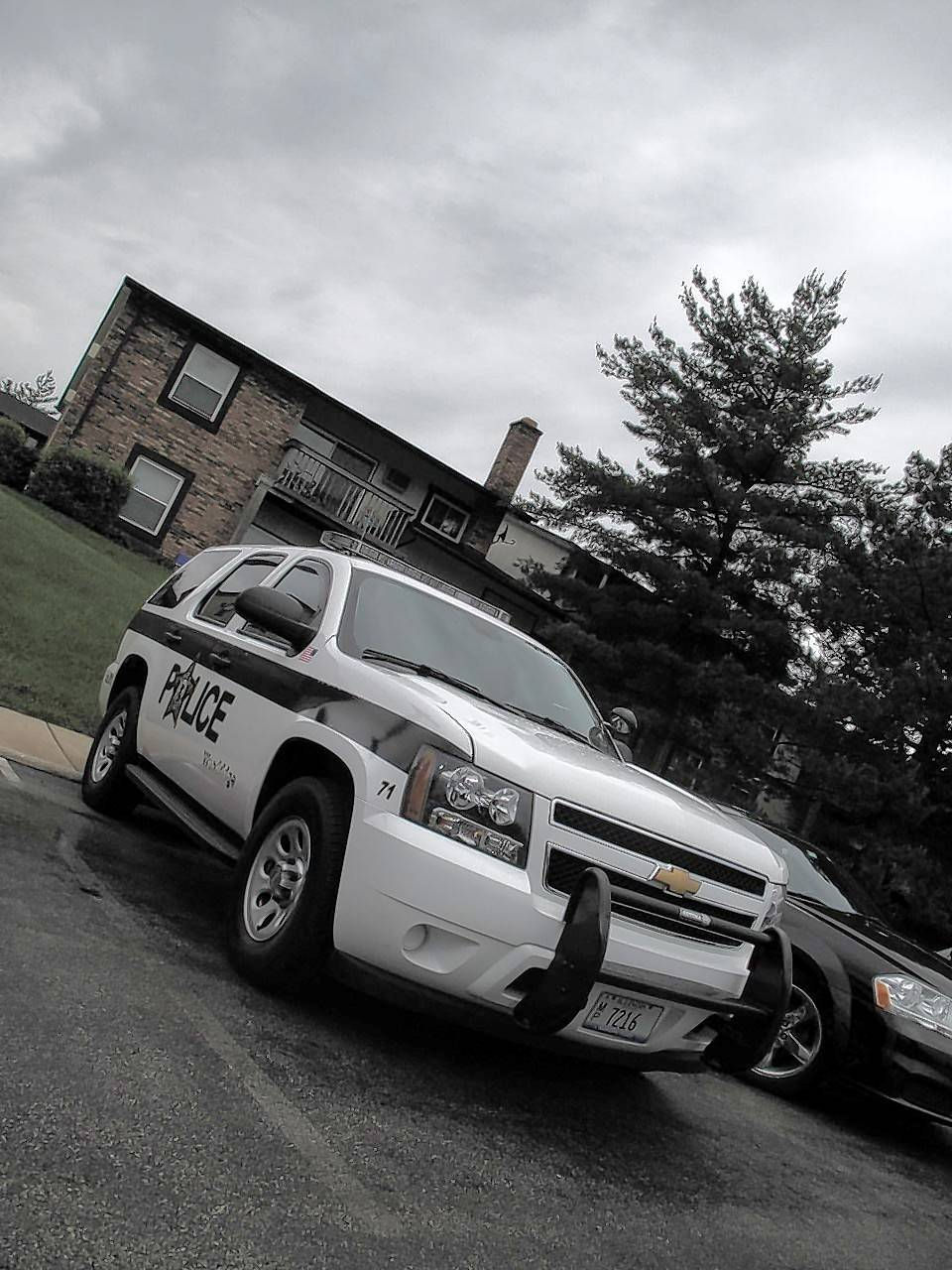 A Woodridge police car sits outside an apartment on the 7700 block of Fox Drive, where a husband and wife were found shot to death late Monday. The DuPage County coroner's office is conducting autopsies on the victims Tuesday.