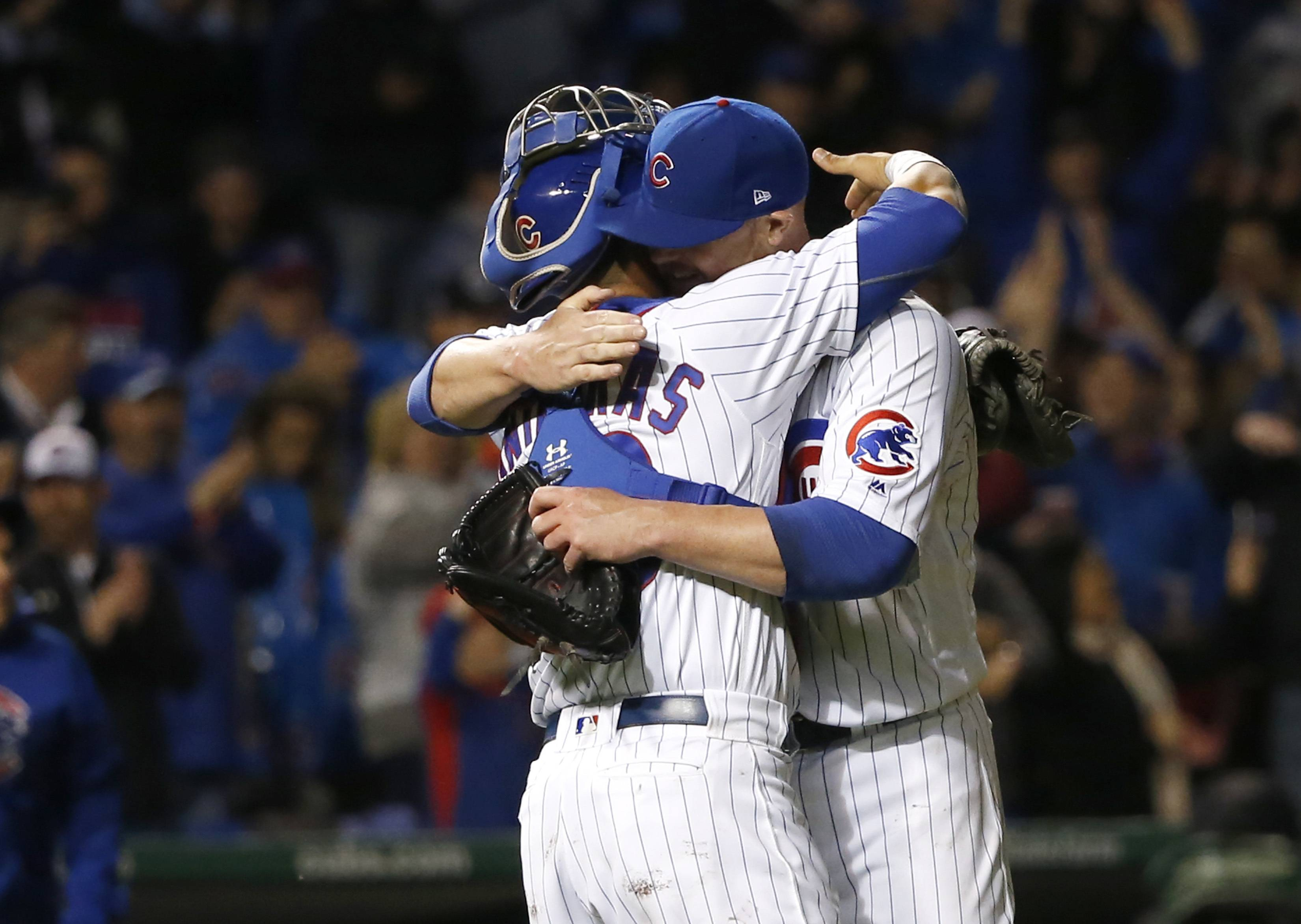 Chicago Cubs catcher Willson Contreras, left, hugs starting pitcher Jon Lester as they celebrate Lester's complete game and the team's 4-1 win over the San Francisco Giants after a baseball game Tuesday, May 23, 2017, in Chicago. (AP Photo/Charles Rex Arbogast)