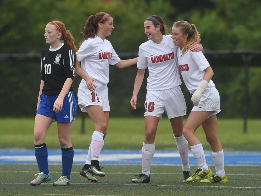 Lake Zurich's Samantha Hartman turns away as Barrington's Anna Brodjian (10) is congratulated for her goal by teammates Ashley Prell (12) and Michayla Herr during Tuesday's girls soccer game in Gurnee.