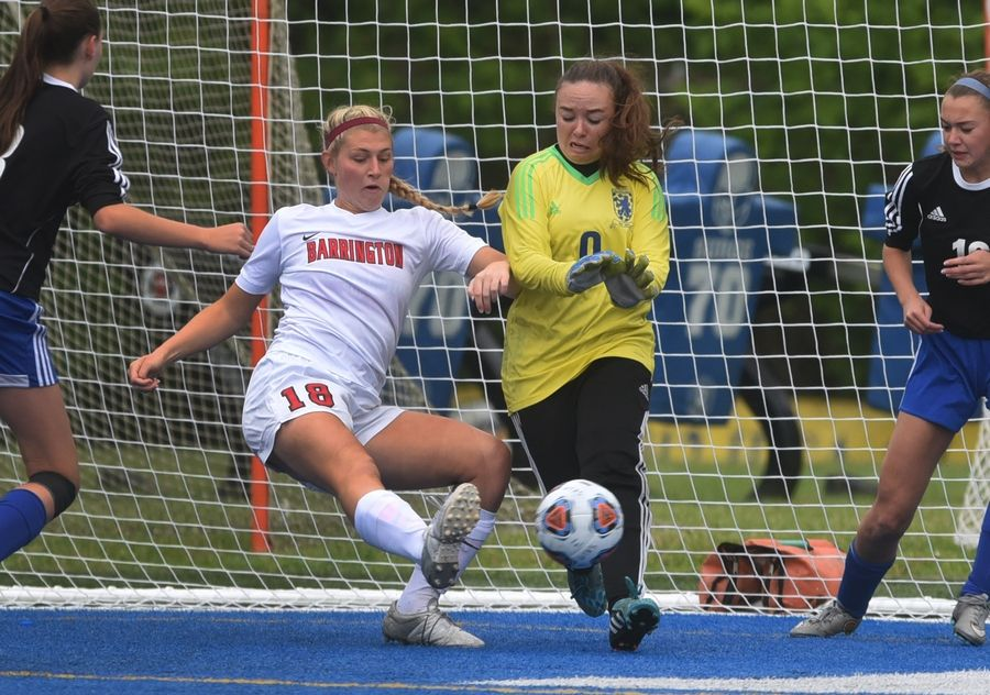 Barrington's Haley Tausend tries to get the ball in the net but Lake Zurich goalie Madison Hart makes a save during Tuesday's soccer game in Gurnee.