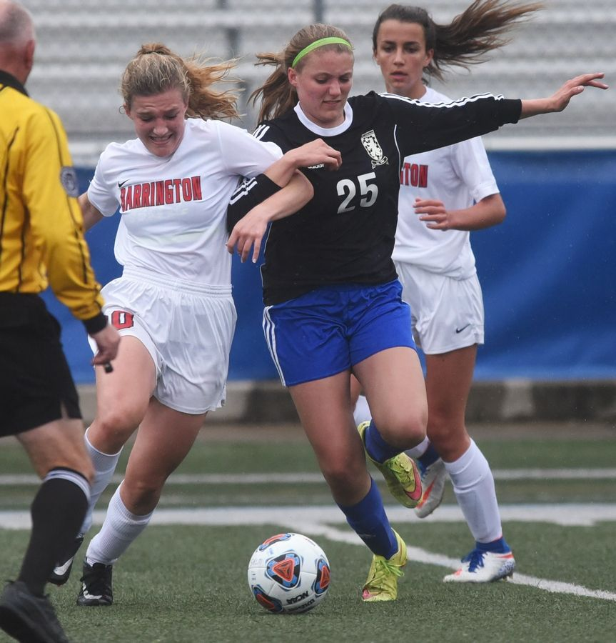 Barrington's Lauren Caffe and Lake Zurich's Maddy Piggott (25) battle for control of the ball during Tuesday's soccer game in Gurnee.