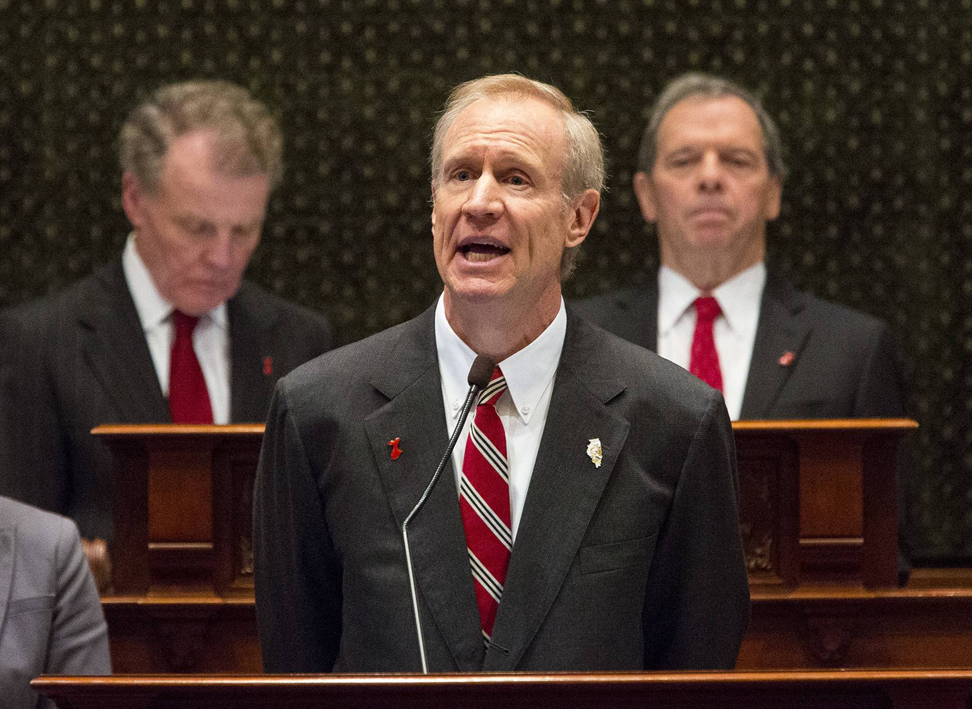 House Speaker Michael Madigan, left, and Senate President John Cullerton listen as Illinois Gov. Bruce Rauner delivers his budget address to a joint session of the General Assembly at the Capitol last February.