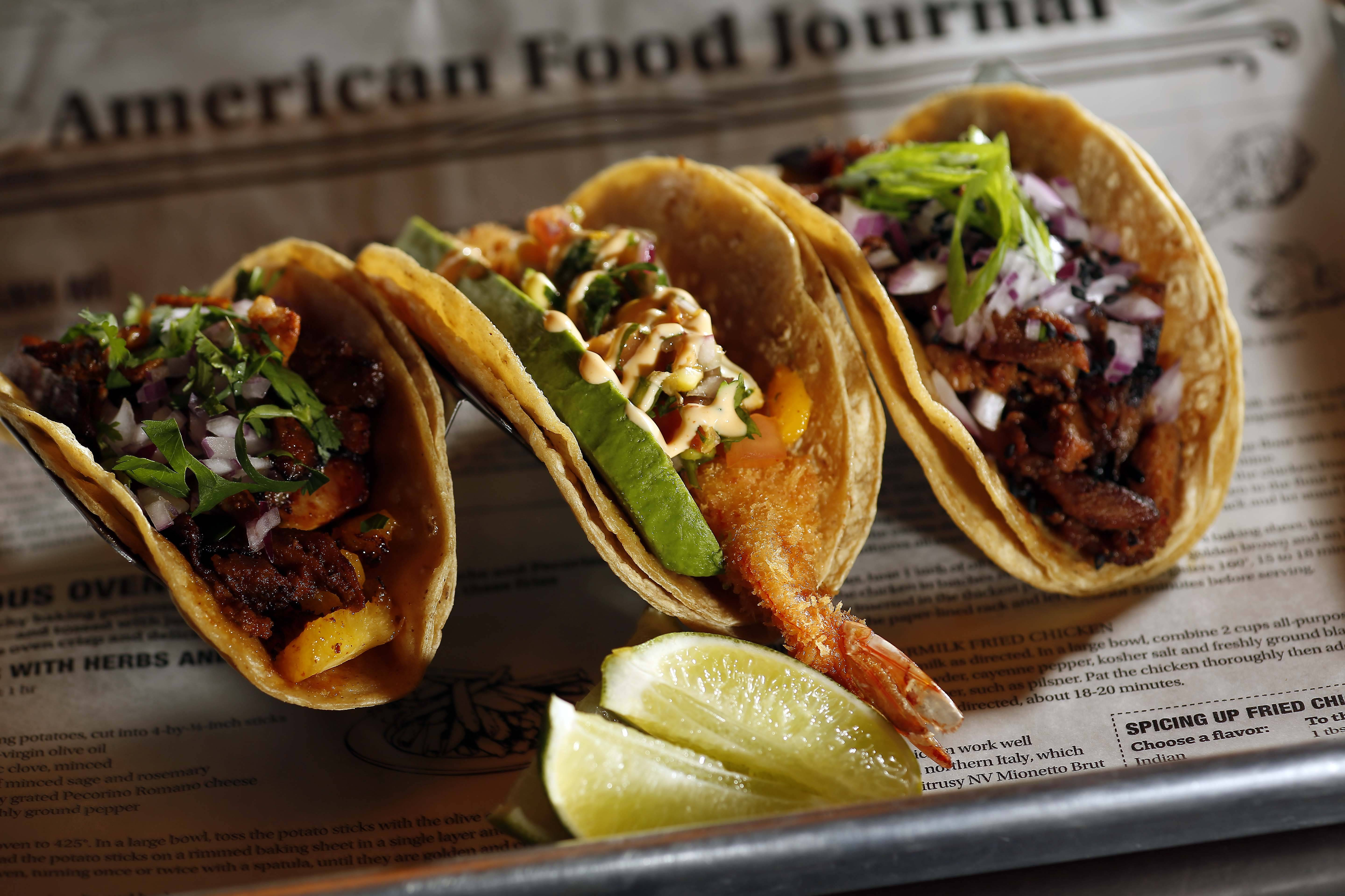 El Cochino serves up fusion tacos like the pastor, left, Panko-breaded shrimp and Korean BBQ pork at the Lake in the Hills restaurant.