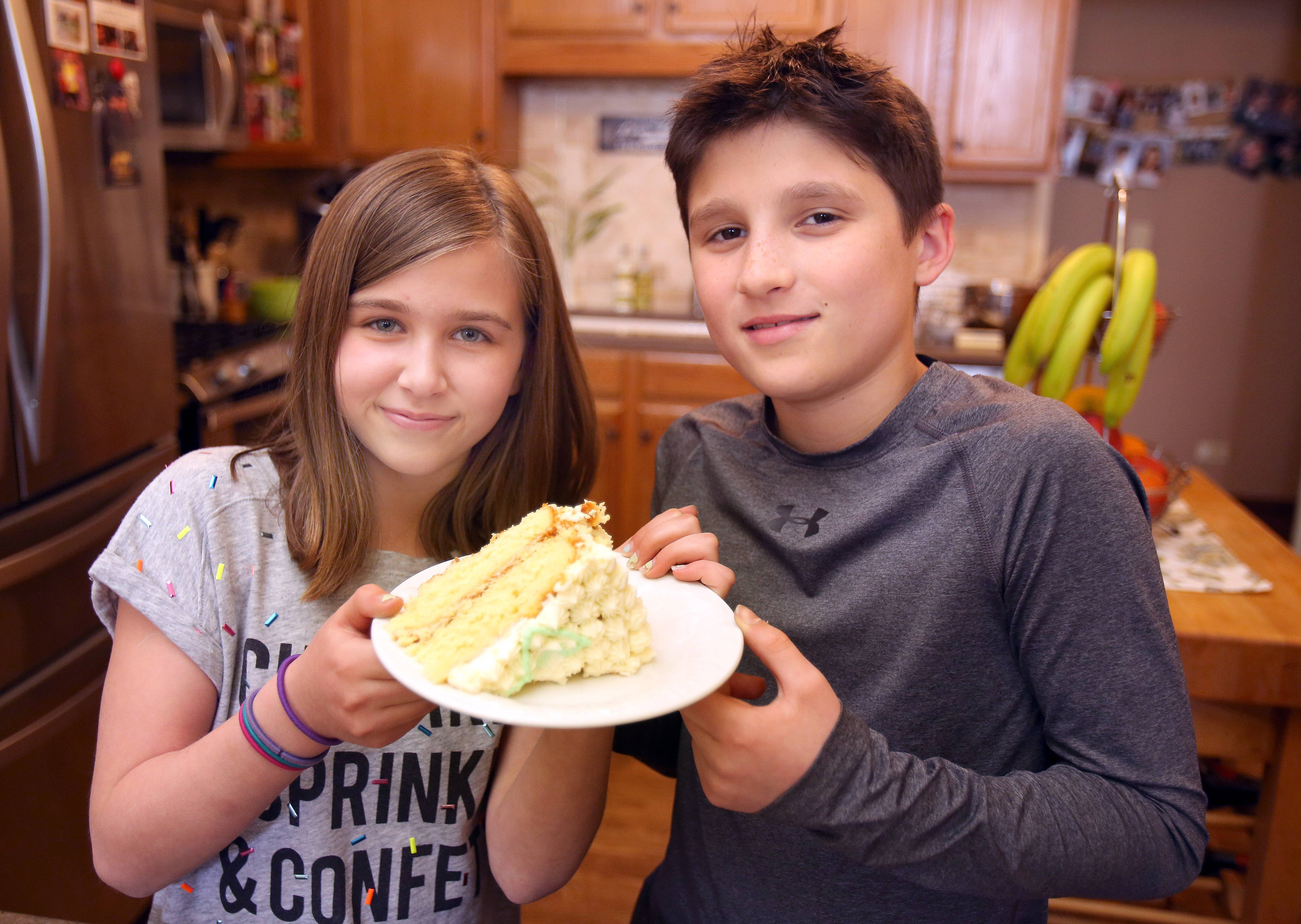 Cousins 11-year-old Audrey Silverman and 9-year-old Blaise LaVista, both of Gurnee hold a piece of their lemon cake.