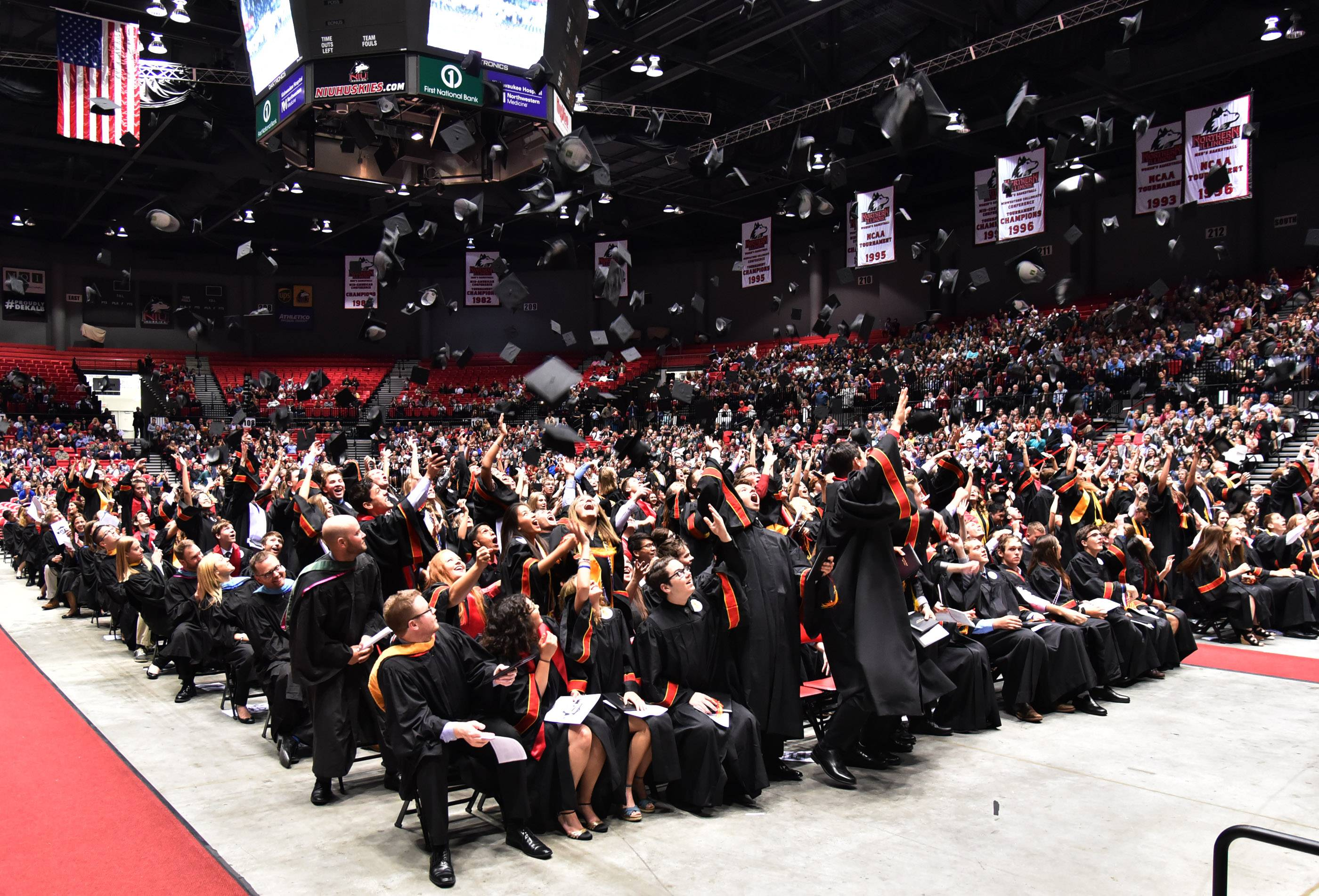 The Batavia High School class of 2017 graduates throw their mortar boards in the air at the end of their commmencement ceremony at Northern Illinois University in DeKalb Wednesday.