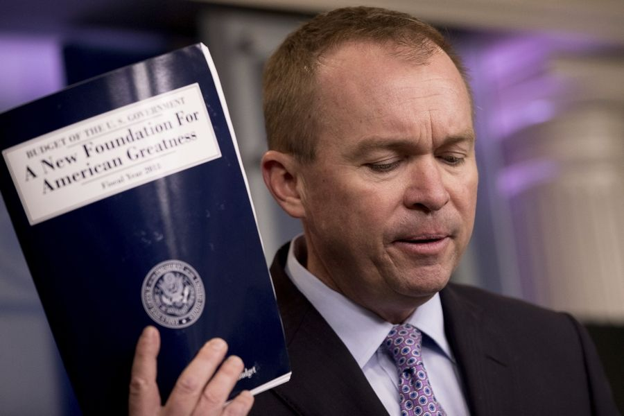 Budget Director Mick Mulvaney holds up a copy of President Donald Trump's proposed fiscal 2018 federal budget as he speaks to members of the media in the Press Briefing Room at the White House in Washington, Tuesday, May 23, 2017.