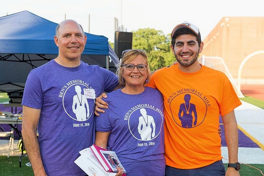 Family members of the late Downers Grove North runner Ben Silver. including his father Paul Silver, his mother Jamie Lee Silver and his older brother Aaron Silver are aiming to have 1,000 participants in the second annual event in his honor, Ben's Memorial Mile on June 17 at the school.