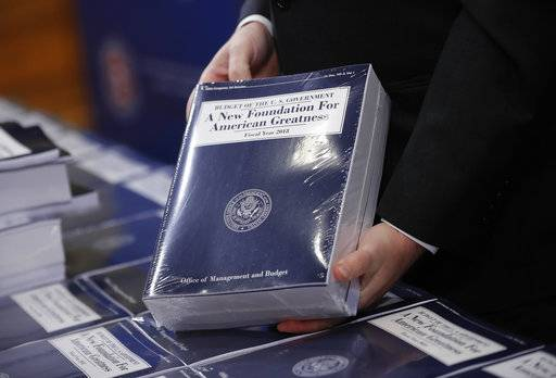 Eric Ueland, Republican staff director, Senate Budget Committee holds a copy of President Donald Trump's fiscal 2018 federal budget, before distributing them to congressional staffers on Capitol Hill in Washington, Tuesday, May 23, 2017. (AP Photo/Pablo Martinez Monsivais)