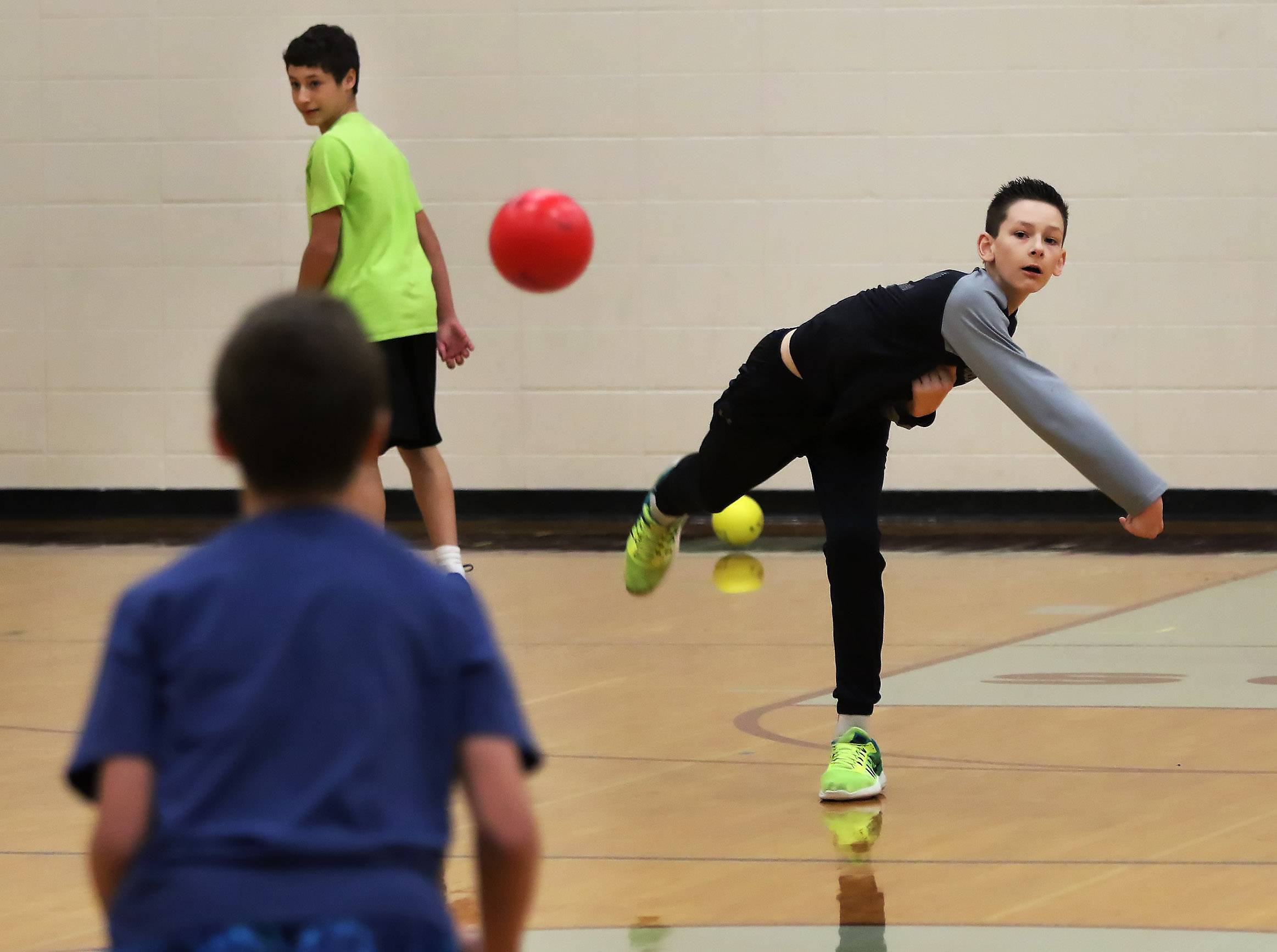 Eighth grader Noah Brondyke of Average Joe's throws against a player from Team Callero during a charity dodgeball tournament Thursday at Lake Zurich Middle School South. The event was hosted by the student council to benefit NephCure, a nonprofit organization that provides support for people who suffer from kidney disease.