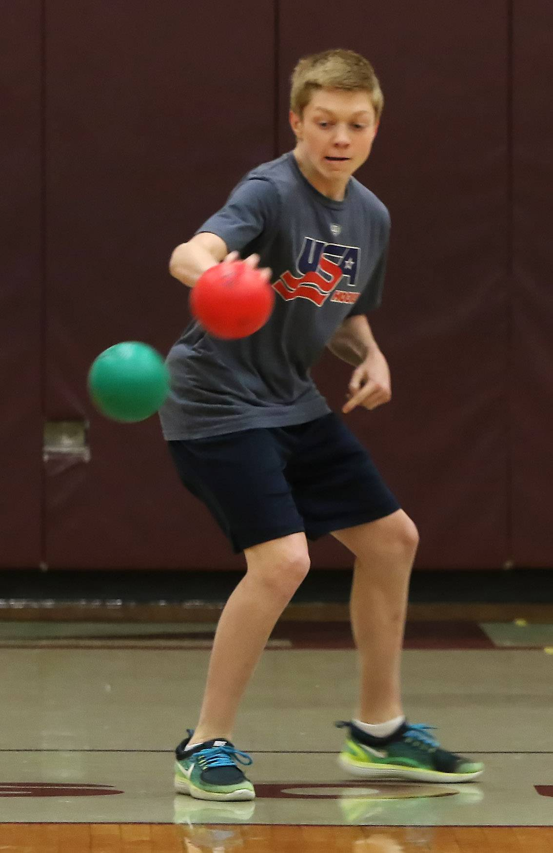 Eighth grader Nick Palmer of Average Joe's dodges a throw by Team Callero during a dodgeball tournament Thursday at Lake Zurich Middle School South. The event was hosted by the student council to benefit NephCure, a nonprofit organization that provides support for people who suffer from kidney disease.