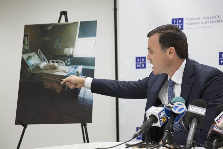 Attorney Sean Murray, during his announcement of a lawsuit on behalf of the nurses held hostage by Tywon Salters at Delnor Hospital in Geneva, shows the room Salters was in as a patient.