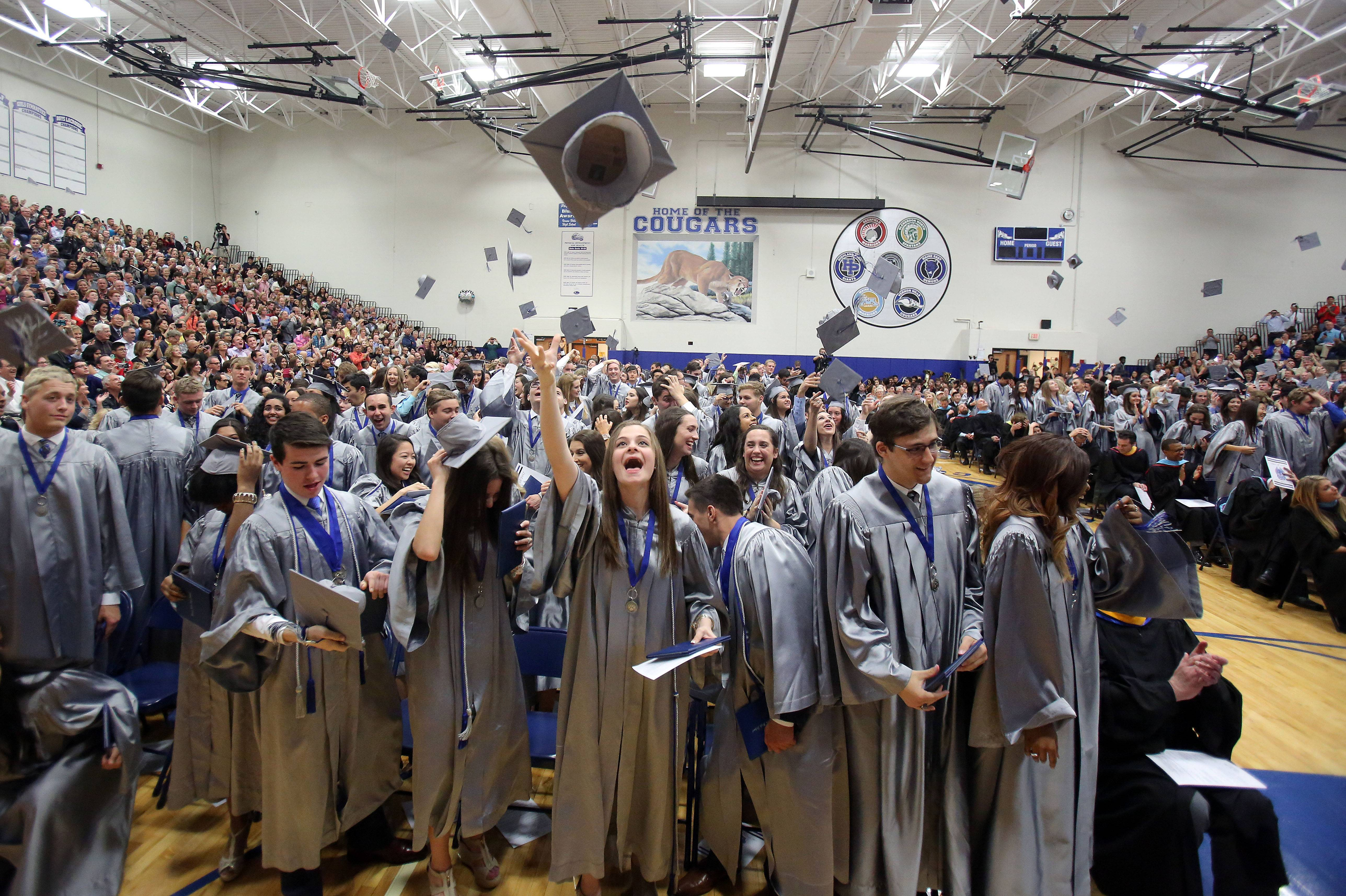Graduates toss their caps as Vernon Hills High School held its graduation ceremony Friday at the high school.