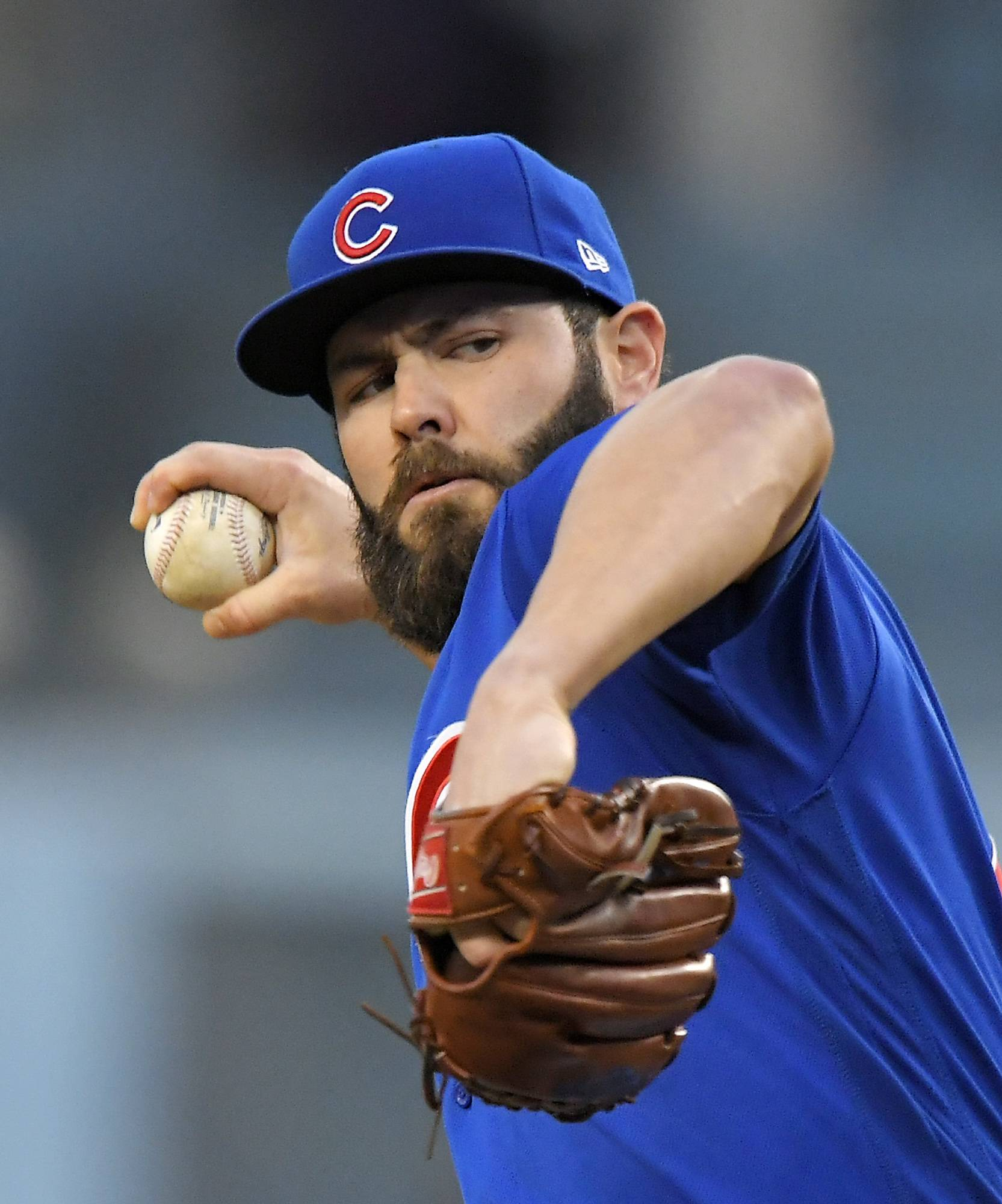 Cubs starter Jake Arrieta throws to the plate during the first inning against the Los Angeles Dodgers on Friday in Los Angeles.