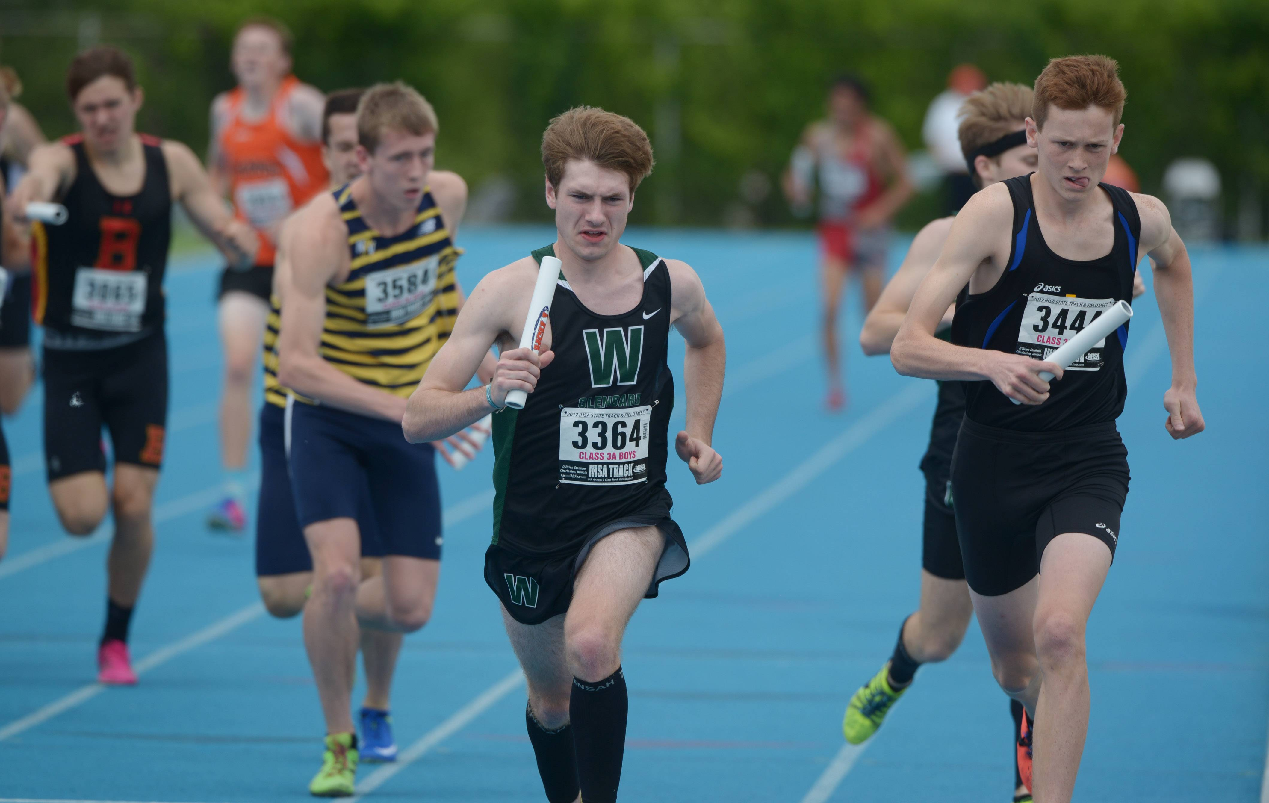 Glenbard West's Kyle Rogus (3364) runs in the class 3A 3,200 meter relay during the boys state track and field preliminaries at Eastern Illinois University in Charleston Friday.