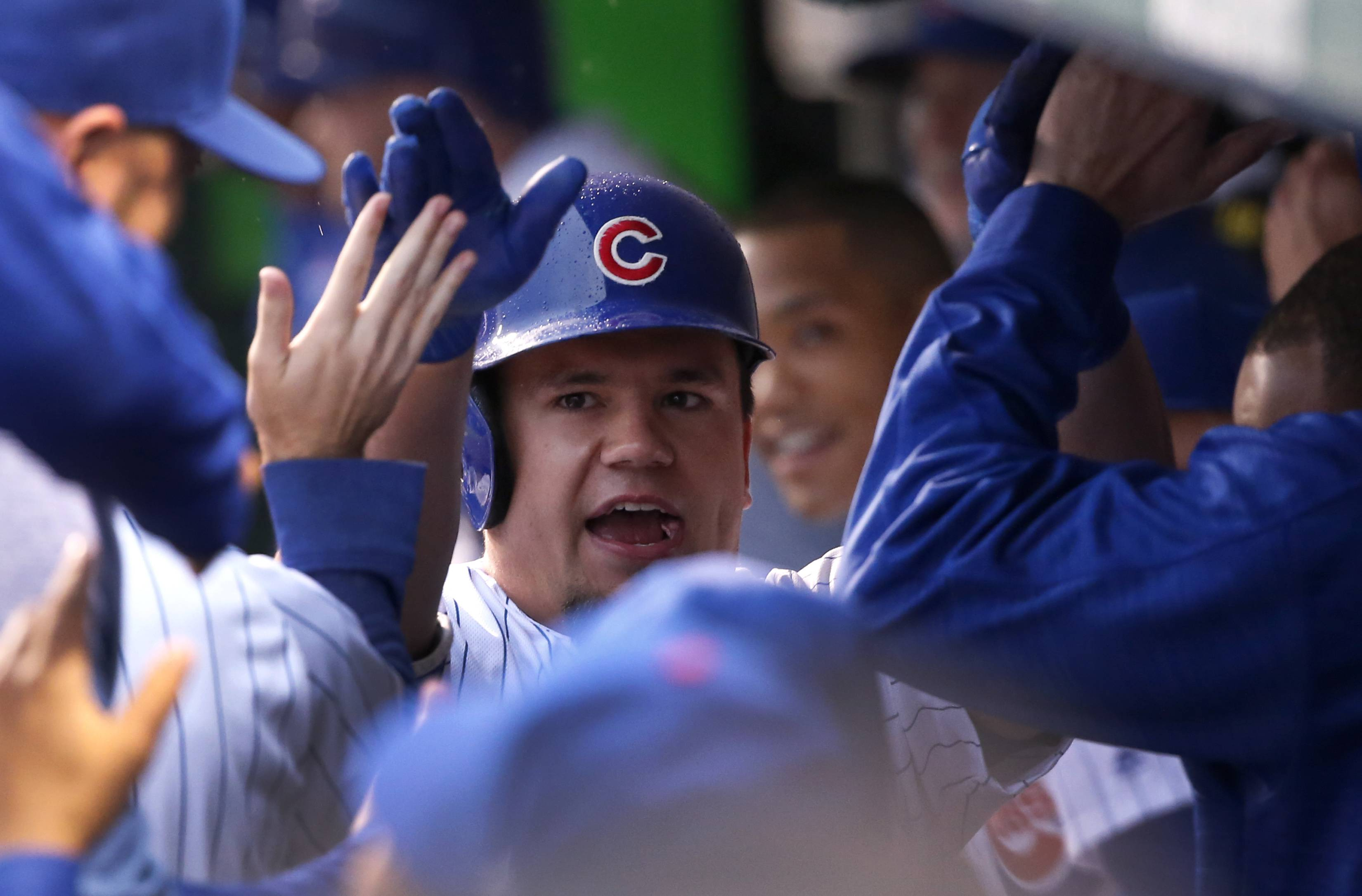 Cubs' Kyle Schwarber celebrates his home run in the dugout off San Francisco Giants starting pitcher Johnny Cueto during the first inning on Tuesday in Chicago.