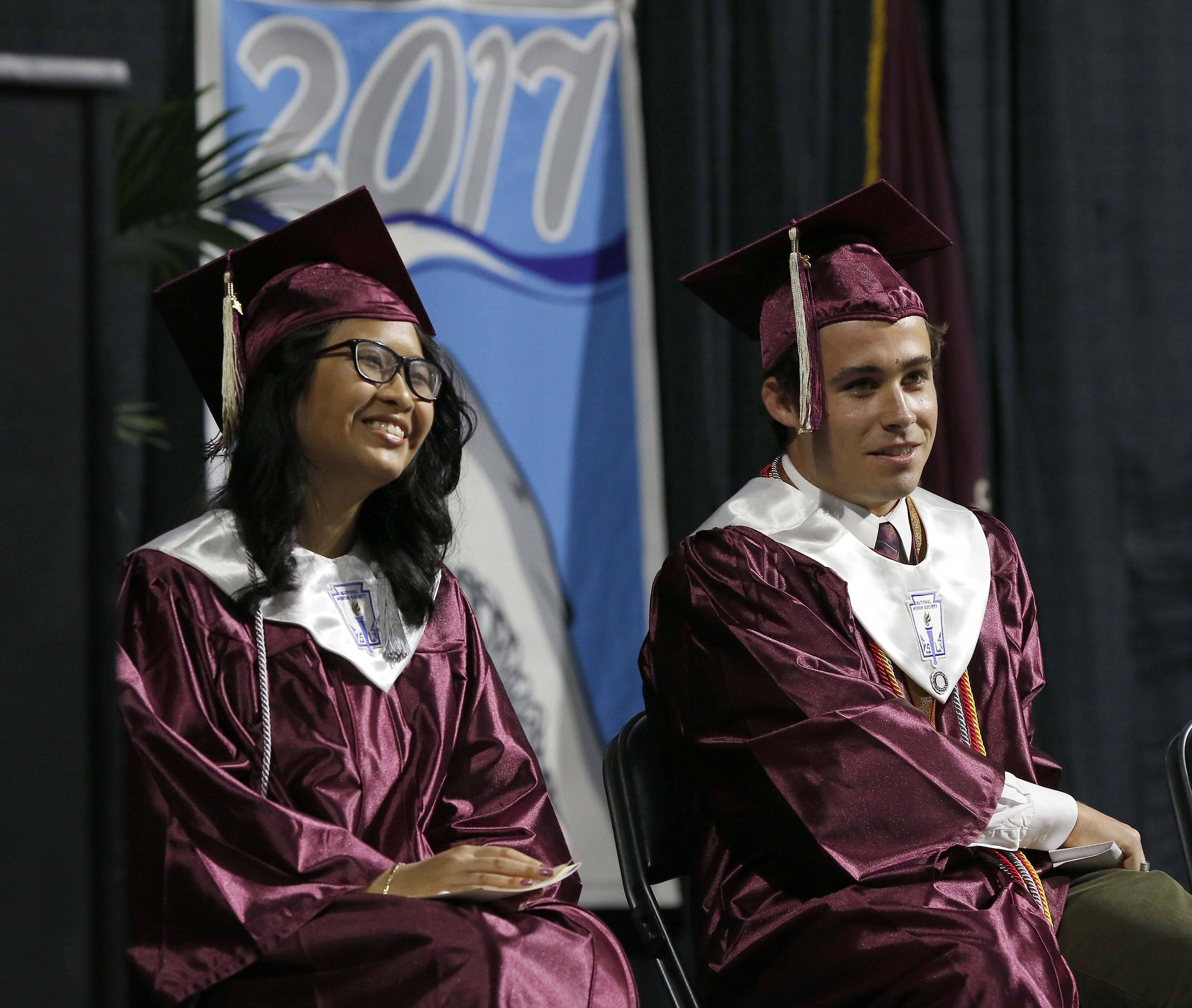 Valedictorians of Elgin High School Class 2017 Anna Bounchaleun and Maximilian Troyke after their speeches during the commencement ceremony, Saturday, May 27 at the Sears Centre in Hoffman Estates.