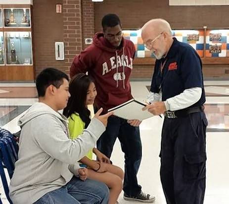 Sven Cederberg, a member of the Buffalo Grove High School security staff, with students.