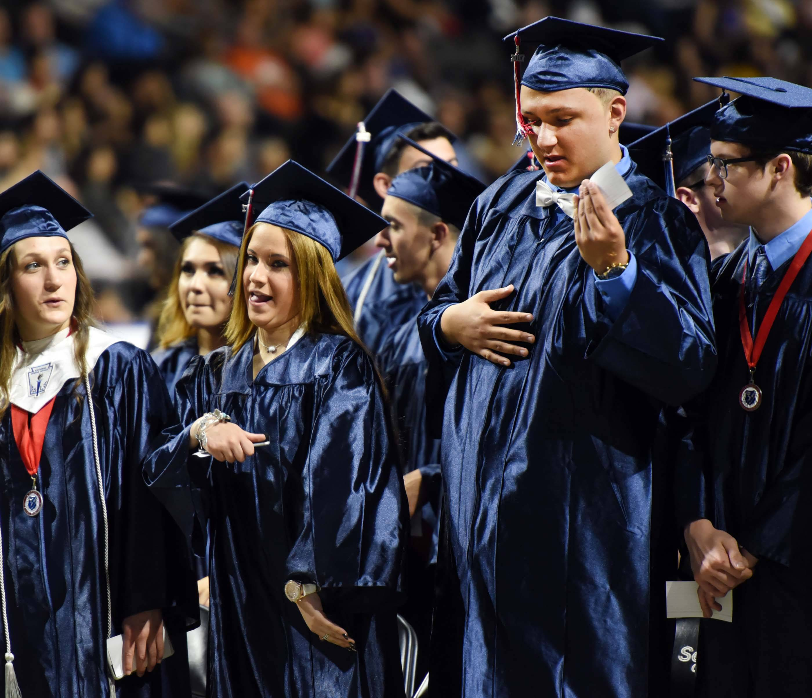 Graduates Amanda Jannet Aldarondo and Joevani M. Alcantar do an impromptu dance at the South Elgin High School Class of 2017 commencement at the Sears Centre in Hoffman Estates Saturday.