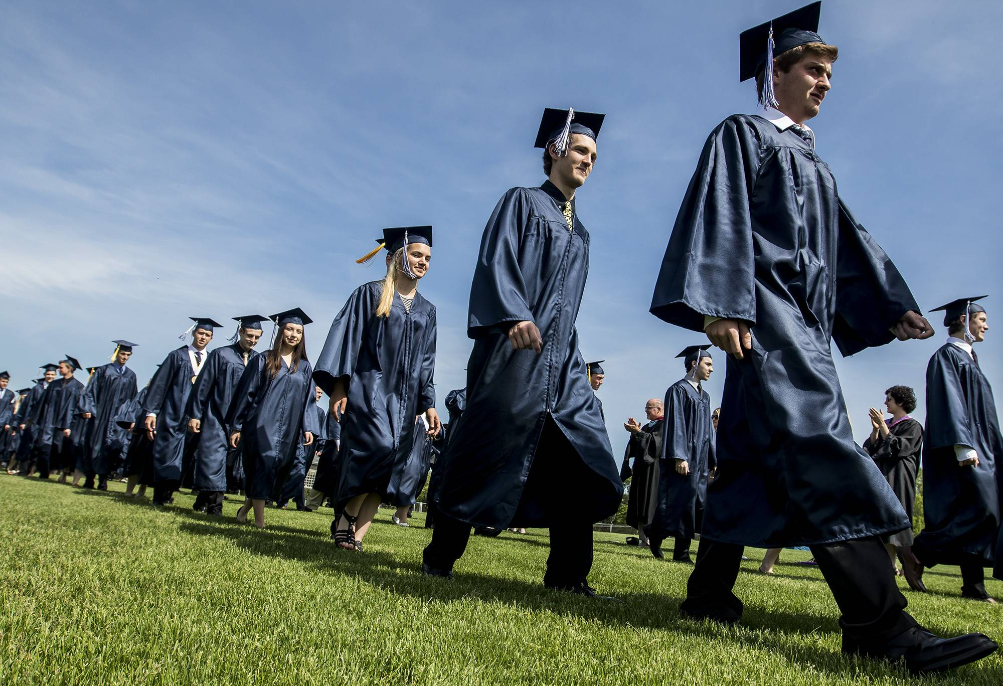 Cary-Grove students walk to their seats during commencement ceremonies at Cary-Grove High School Saturday, May 27, 2017.
