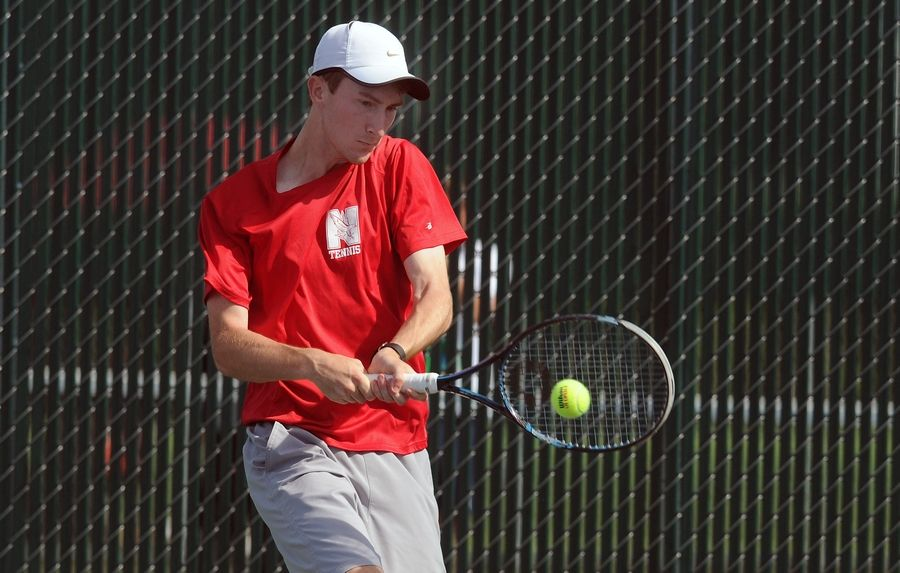 Ryan Roegner of Naperville Central returns a backhanded slam in the Class 2A singles against Danilo Kovacevic of Maine South in boys semifinals state tennis at Hersey on Saturday.