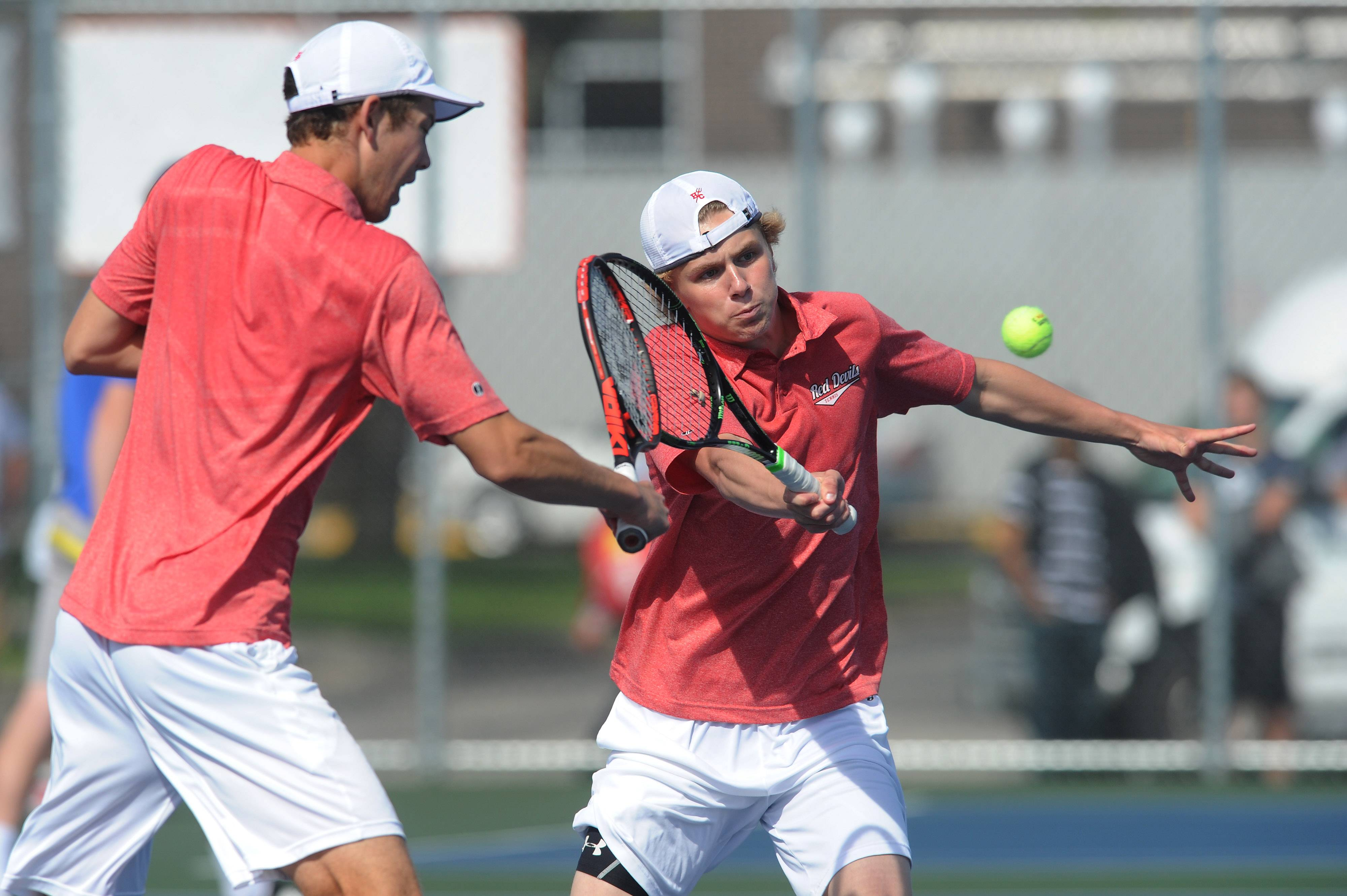 Hinsdale Central's Trevor Hamilton returns a slam as his partner Andrew Buhelos backs him up in the Class 2A Doubles boys semifinals tennis at Hersey on Saturday. They were playing Sebastien DesRoberts and Rohan Gupta of Glen Brook South.
