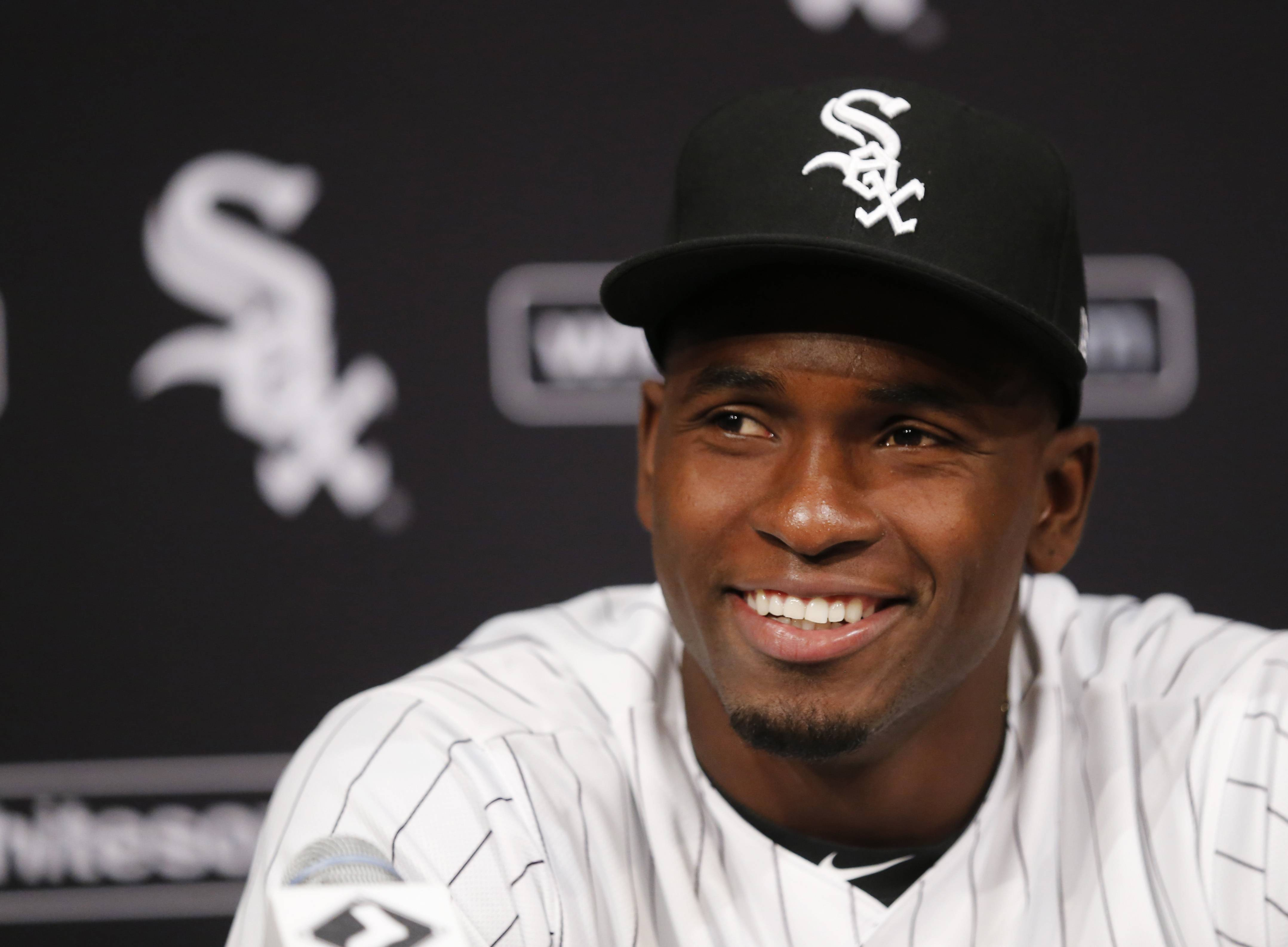 Cuban outfielder Luis Robert smiles at a news conferences after signing with the Chicago White Sox before a baseball game between the White Sox and the Detroit Tigers on Saturday, May 27, 2017, in Chicago.