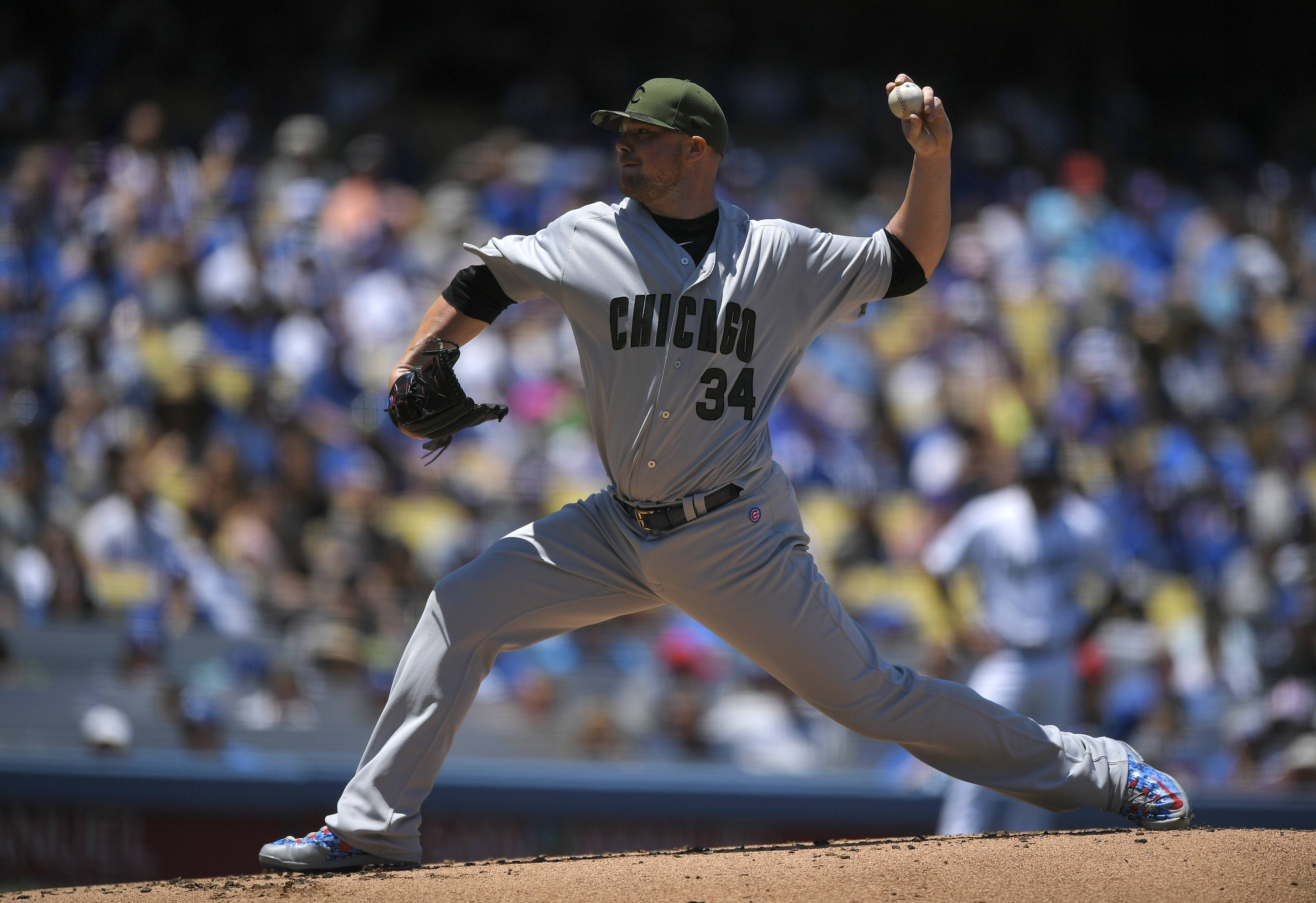 Major-league players such as Chicago Cubs starting pitcher Jon Lester are wearing camouflage this weekend to commemorate Memorial Day, but a pro athletes' commitment to the military not so long ago was so much more.