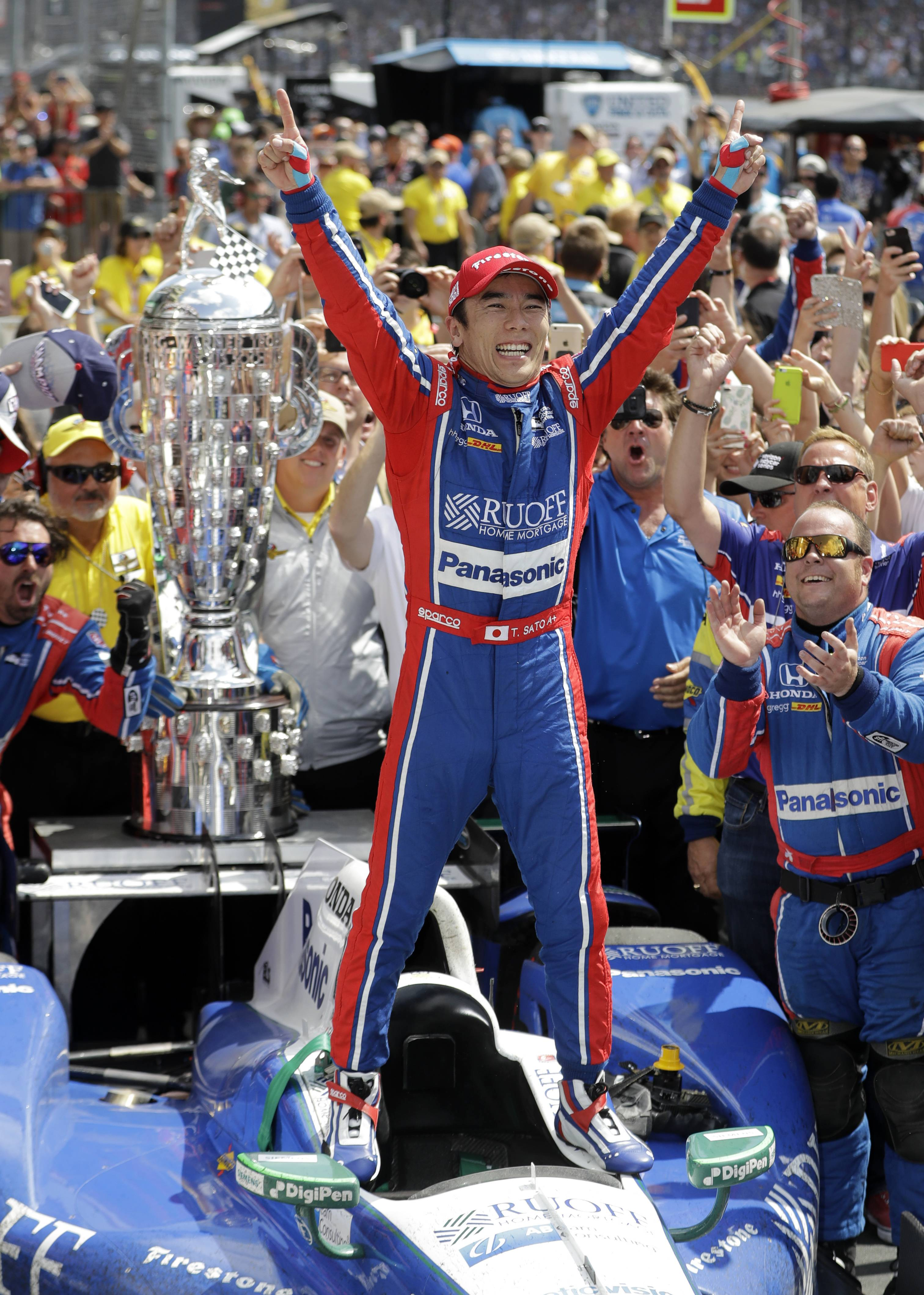 Takuma Sato, of Japan, celebrates after winning the Indianapolis 500 auto race at Indianapolis Motor Speedway, Sunday, May 28, 2017, in Indianapolis.