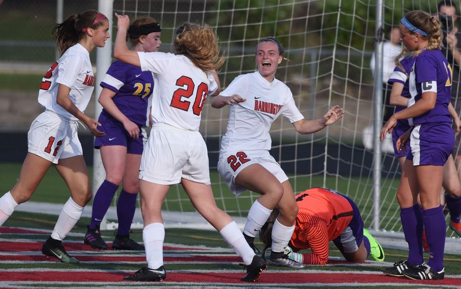 Barrington's Sydney Bowling (22) celebrates a first-half goal with teammates Lauren Caffe (20) and Ashley Prell (12) after scoring past Rockton Hononegah keeper Alyssa Darling during the Class 3A girls soccer Barrington supersectional Tuesday.