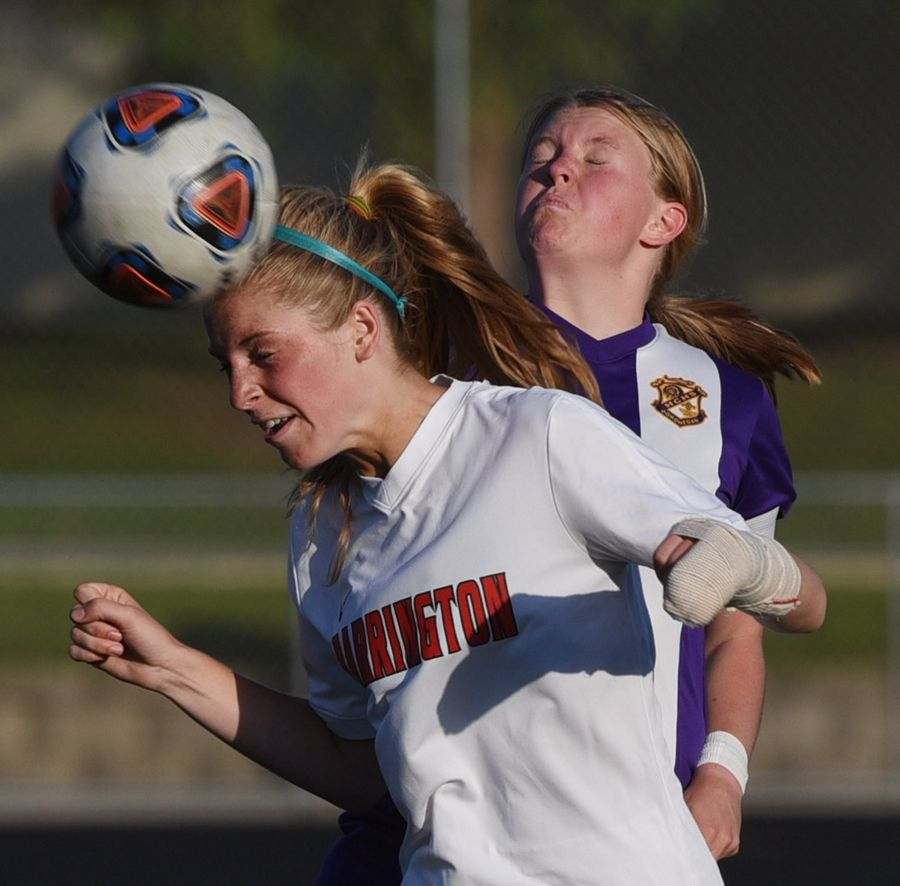 Barrington's Michayla Herr gets in front of Rockton Hononegah's Brynn Jacobi for a header during the Class 3A girls soccer Barrington supersectional Tuesday.