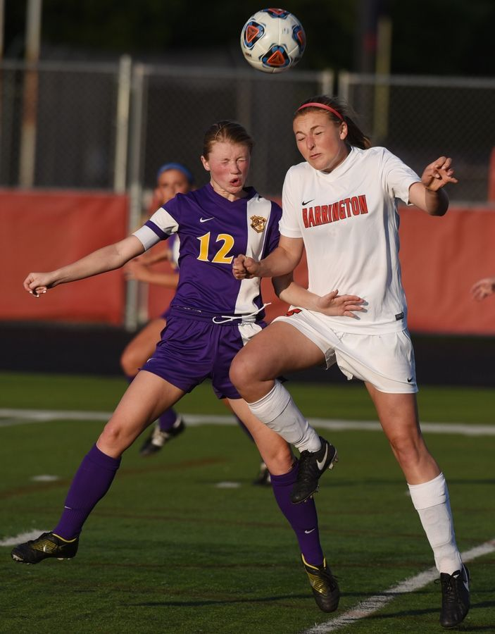 Rockton Hononegah's Taylor Mase, left, and Barrington's Ellie Stodola leap for a header during the Class 3A girls soccer Barrington supersectional Tuesday.
