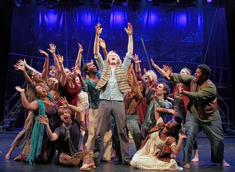 "Jonathan Stombres, center, plays newly drafted Claude in the Metropolis Performing Arts Centre's revival of the 1967 rock musical ""Hair."""