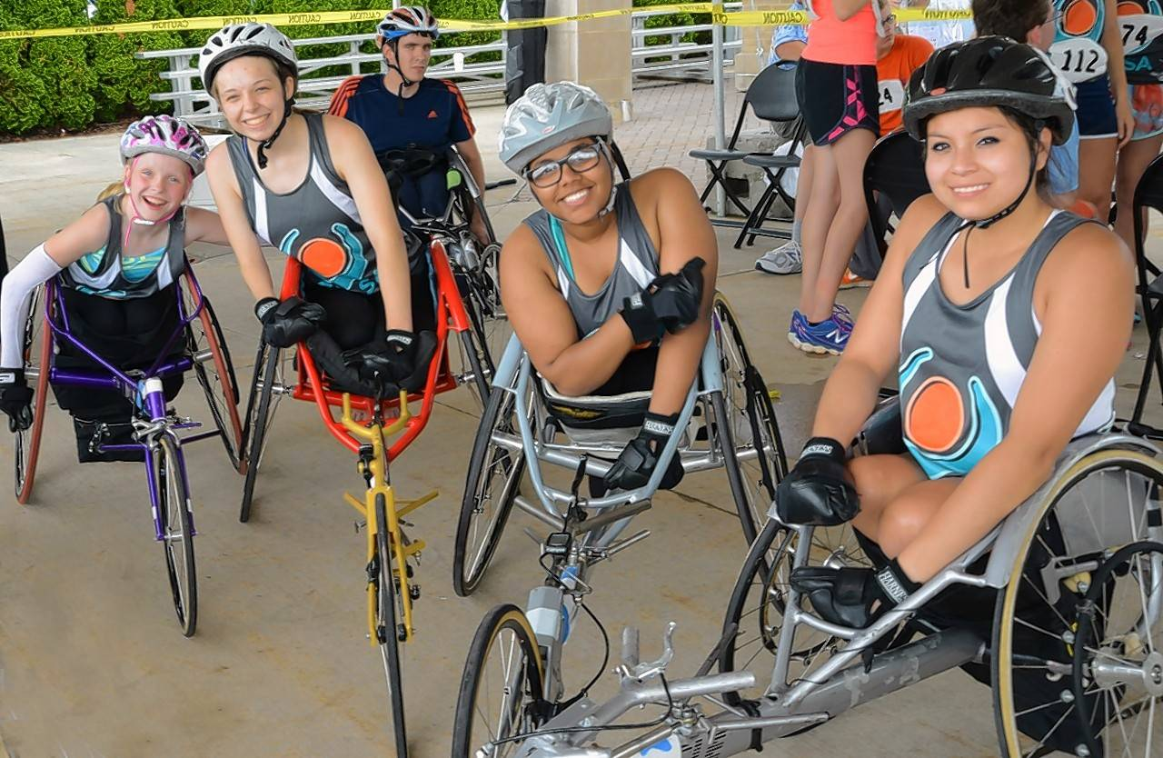 GLASA athletes in racing wheelchairs, ready to take part in track events. Events scheduled for the Adult National Open and Great Lakes Regional Games include swimming, track, field, boccia, archery, power lifting and air rifles.
