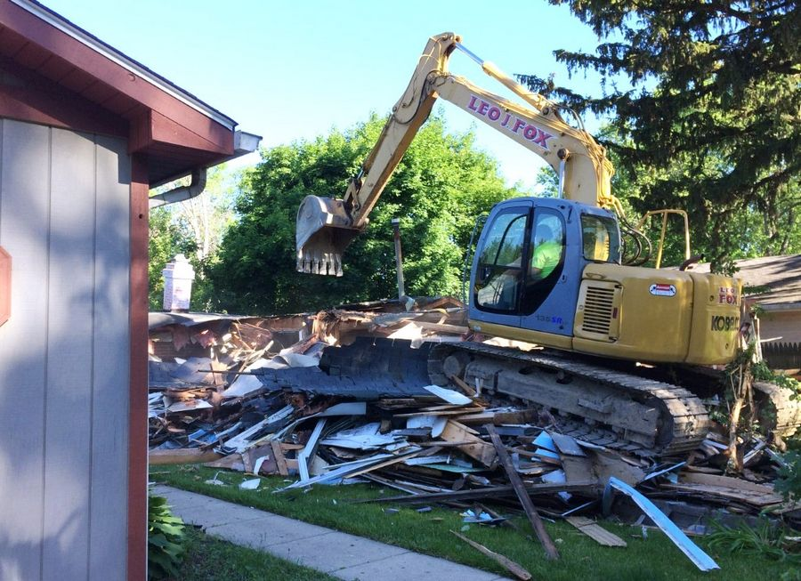 A vacant home at 1218 Juneway Terrace in Round Lake Beach was demolished Wednesday by the village, part of an ongoing effort to improve neighborhoods by razing structures that have been deemed vacant and abandoned.