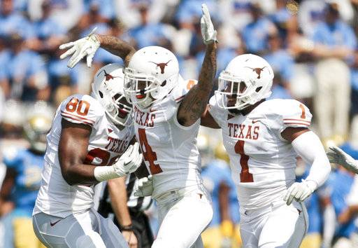 "FILE - In this Sept. 17, 2011, file photo, Texas safety Kenny Vaccaro (4) celebrates intercepting a pass by UCLA quarterback Kevin Prince with teammates Keenan Robinson (1) and Alex Okafor (80) during an NCAA college football game in Pasadena, Calif. Okafor joined the New Orleans Saints as a free agent this offseason, hoping to start at defensive end after playing as a reserve last season with the Arizona Cardinals. In New Orleans, Okafor has joined one of his best friends and former college teammate at Texas, safety Vaccaro. Vaccaro says Okafor is a ""dream fit� for New Orleans' defense."
