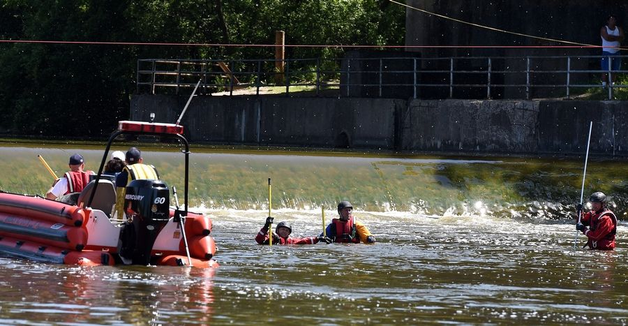 Rescue workers search the Fox River south of the dam in Algonquin Friday for a man last seen in the river Thursday night.