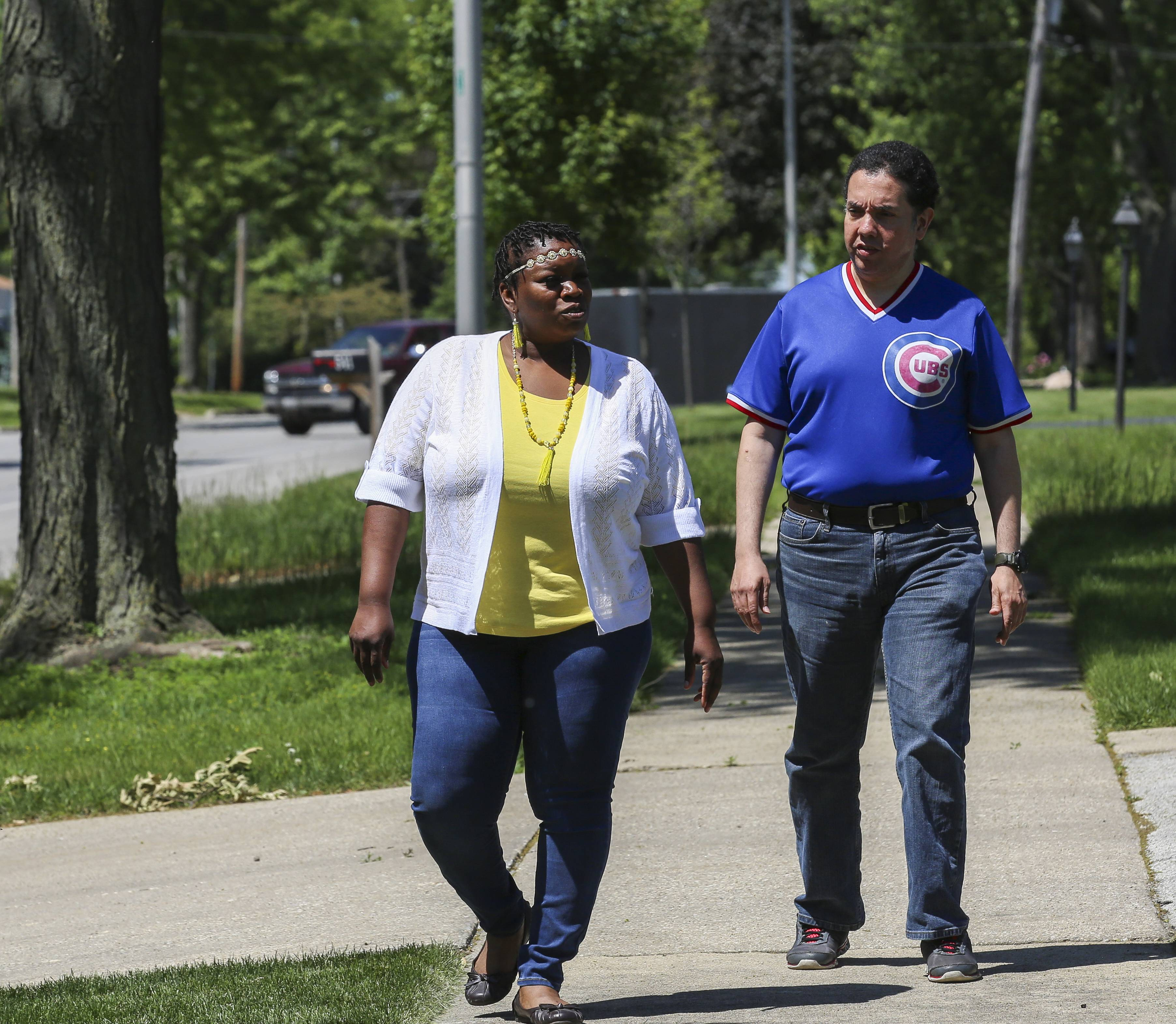 Direct Support Professional Essie Martin and Eddie Arroyo take a walk outside the Ray Graham Association community-based home in Lombard.