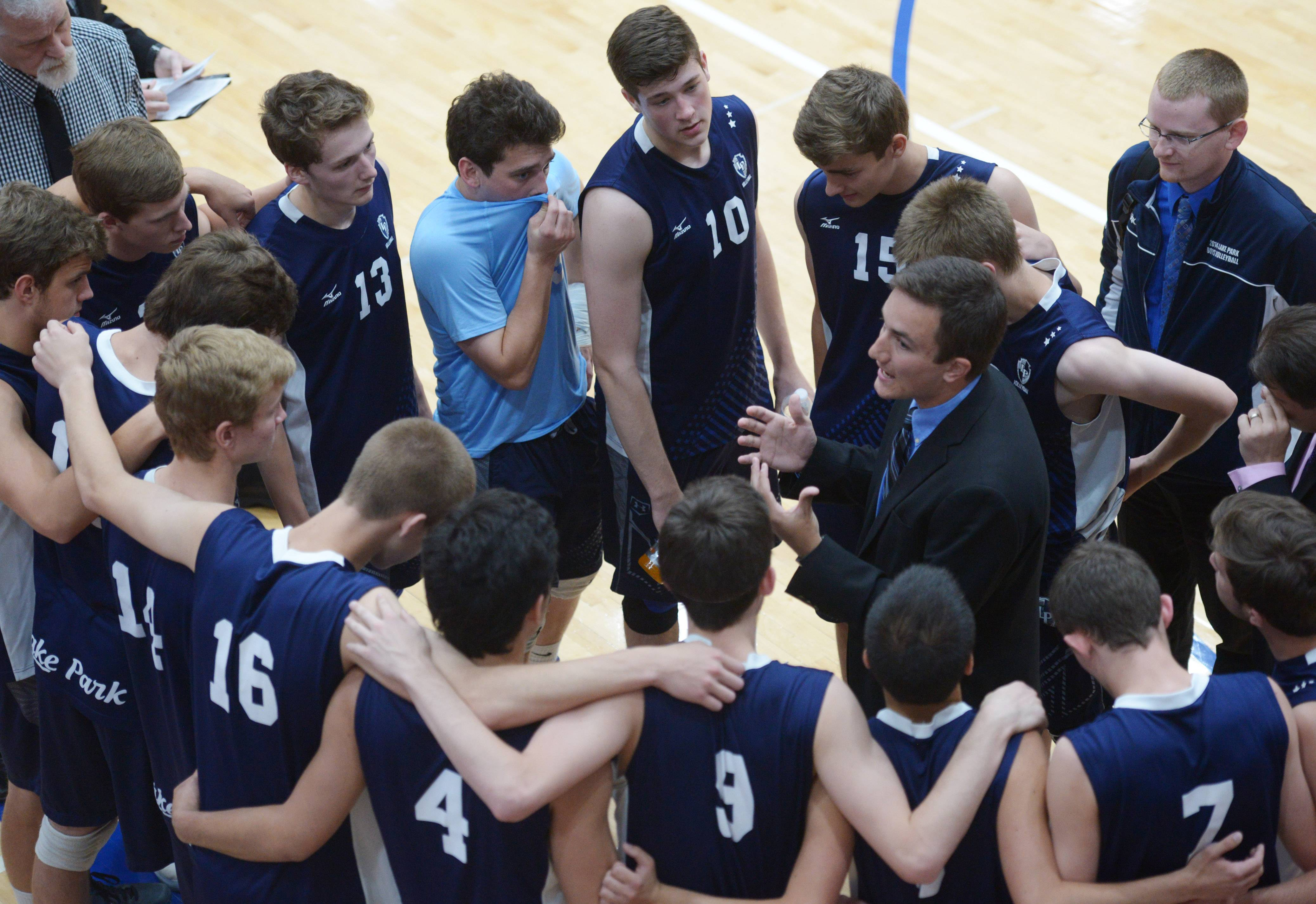 Lake Park players and coaches discuss their game plan during the boys volleyball state quarterfinals at Hoffman Estates High School Friday.